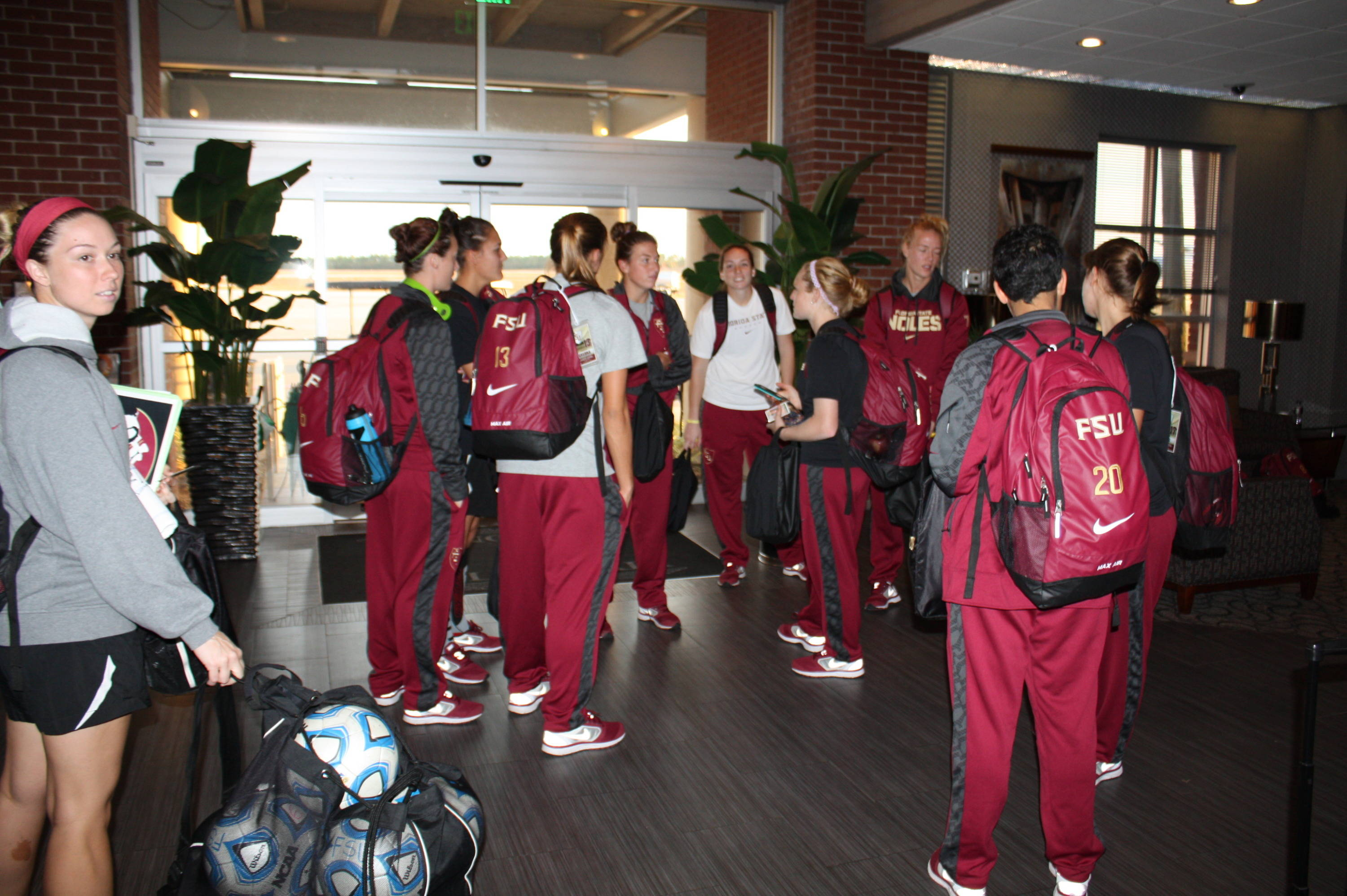 The Florida State soccer team in the airport headed to the College Cup in Cary.