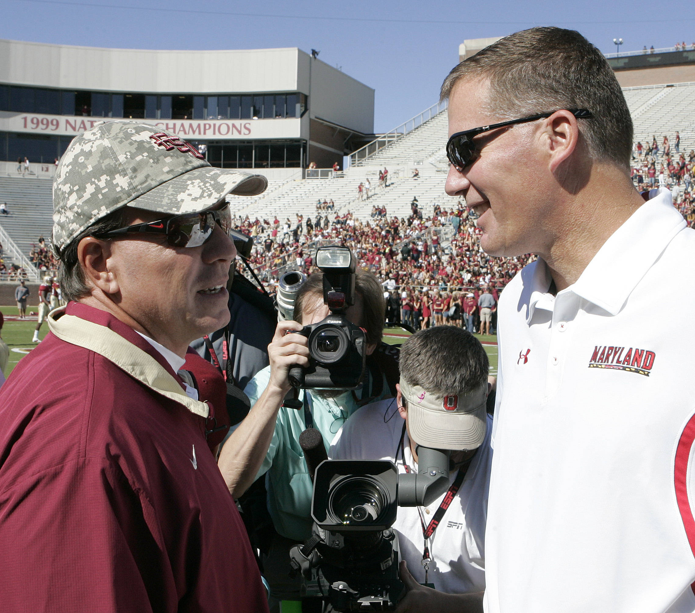 Jimbo Fisher Maryland head coach Randy Edsall at midfield.(AP Photo/Steve Cannon)