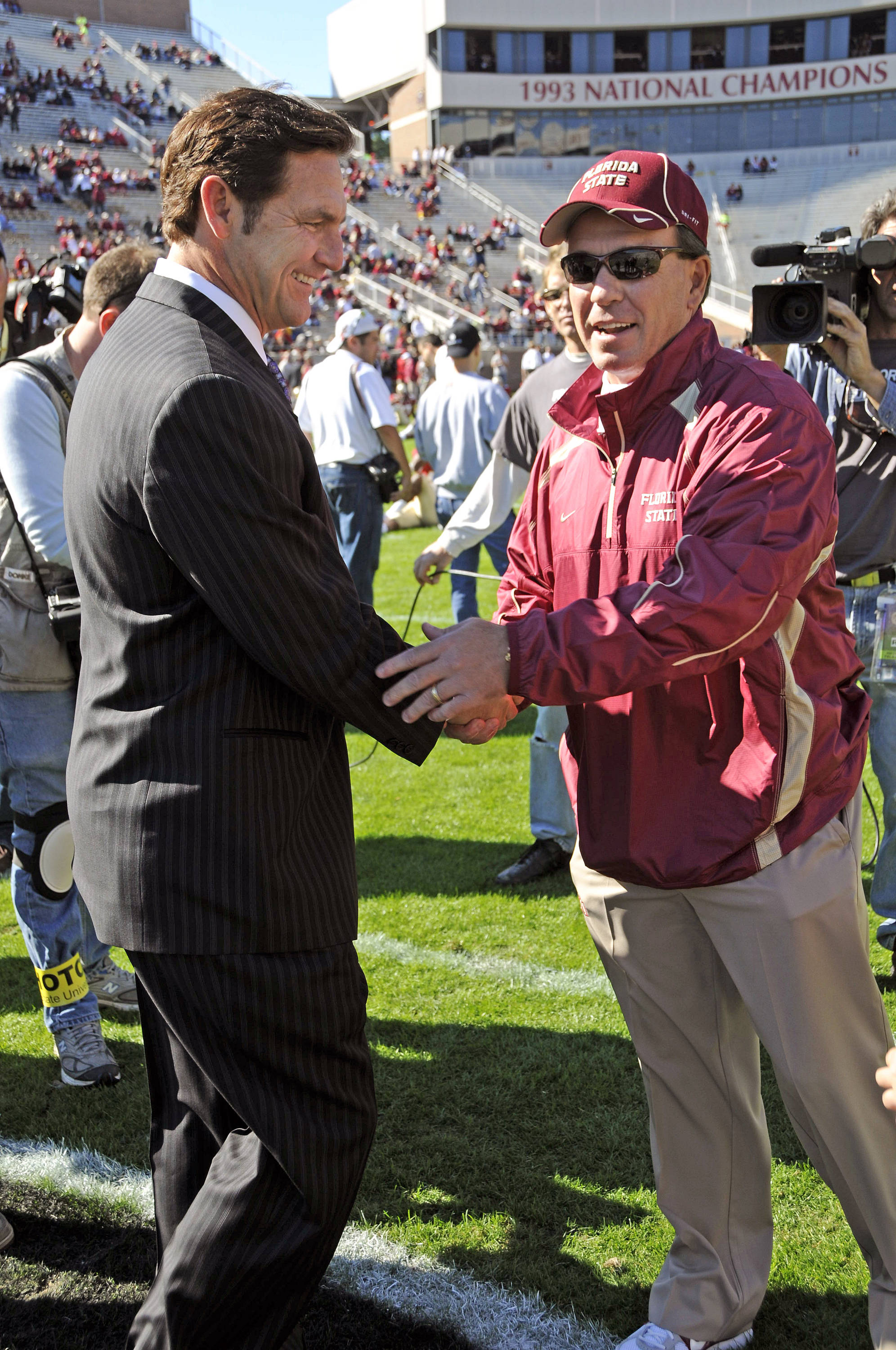 Jimbo Fisher and Craig James meet at midfield