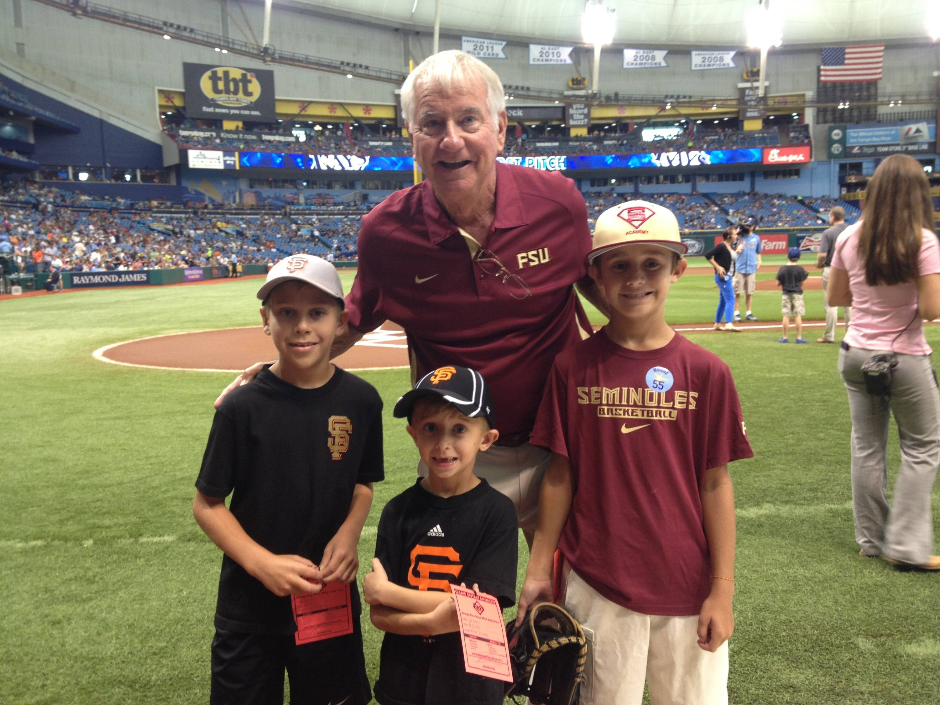 Florida State head coach Mike Martin with grandson T.J. and friends of the Martin family.