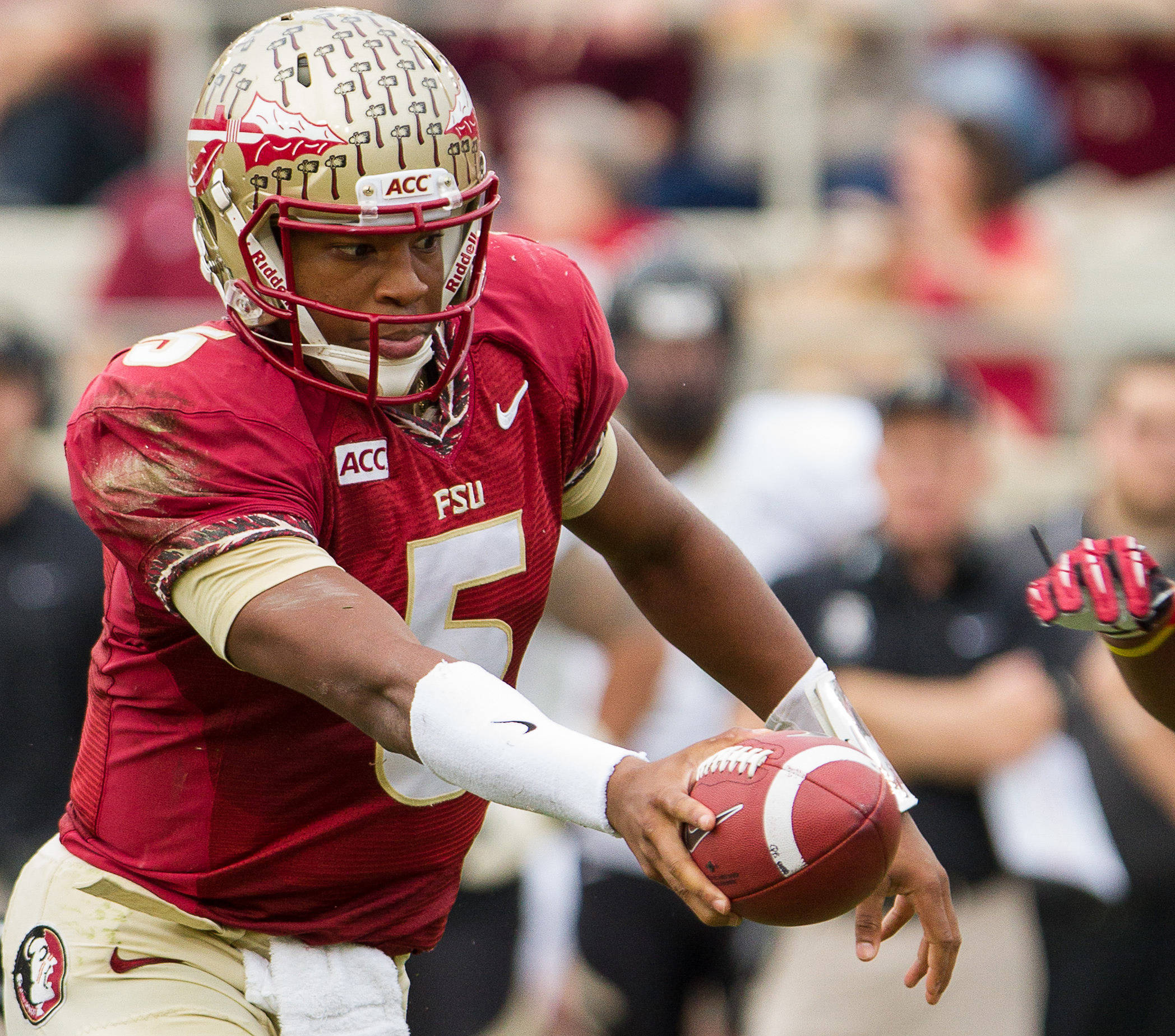 Jameis Winston (5) makes a handoff during FSU Football's 80-14 victory over Idaho in Tallahassee, Fla on Saturday, November 23, 2013. Photos by Mike Schwarz.