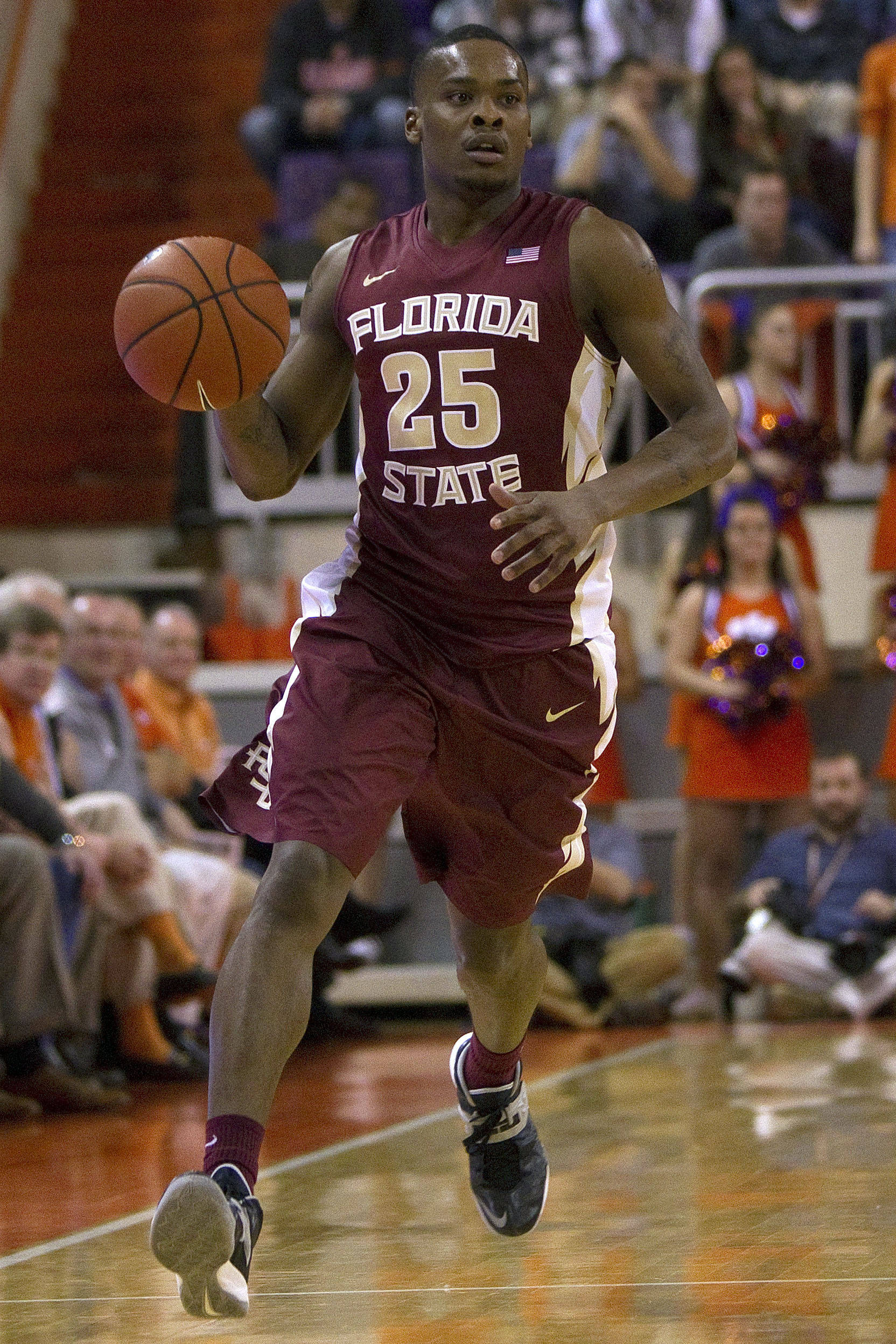 Jan 9, 2014; Clemson, SC, USA; Florida State Seminoles guard Aaron Thomas (25) on a fast break during the first half against the Clemson Tigers at J.C. Littlejohn Coliseum. Mandatory Credit: Joshua S. Kelly-USA TODAY Sports