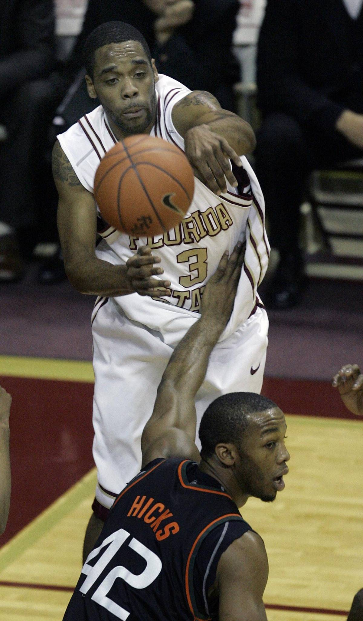 Florida State's Isaiah Swann, top, goes over Miami's Raymond Hicks to make a first-half pass during a college basketball game, Saturday, Jan. 20, 2007, in Tallahassee, Fla. (AP Photo/Phil Coale)<br>