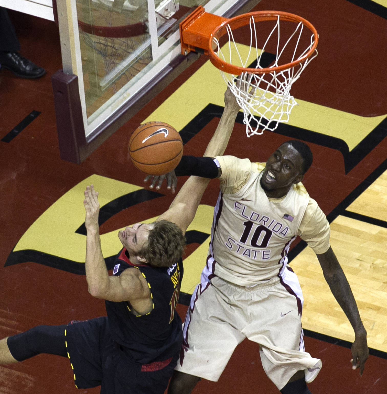 Okaro White (10),  with a rejection at the net, FSU vs Maryland, 1-12-14, (Photo's by Steve Musco)