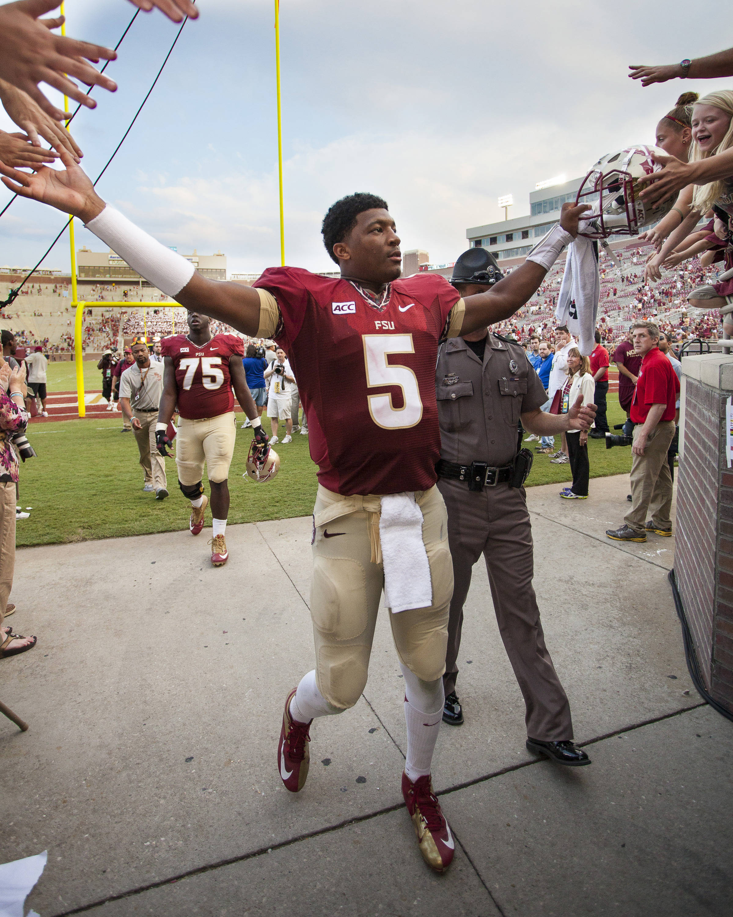 Jameis Winston (5) high fives fans after FSU's 62-7 win over Nevada on Saturday, Sept 14, 2013 in Tallahassee, Fla.