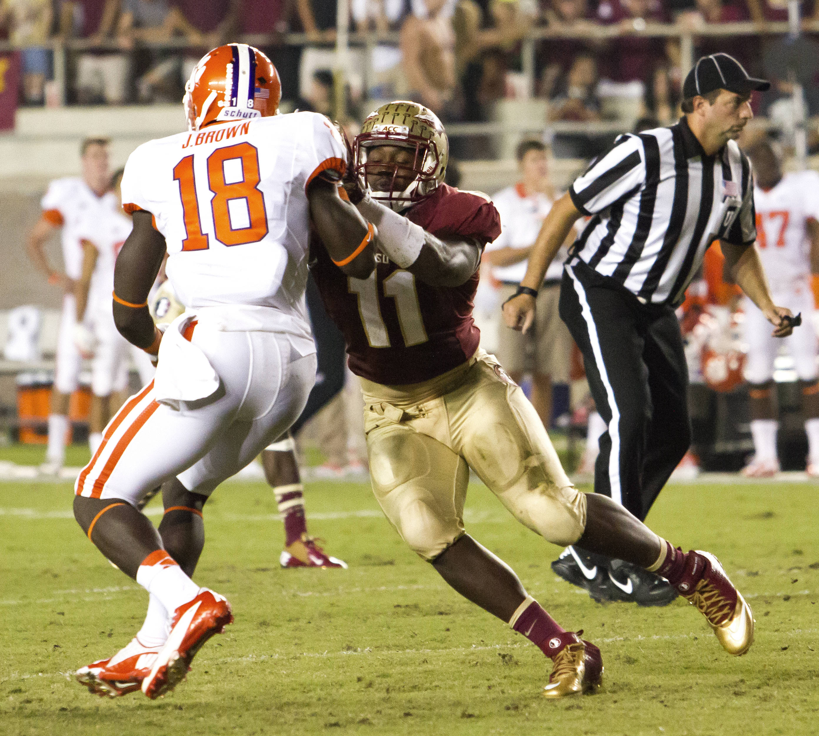 Vince Williams (11) slowing down a receiver, FSU vs Clemson, 9/22/12 (Photo by Steve Musco)