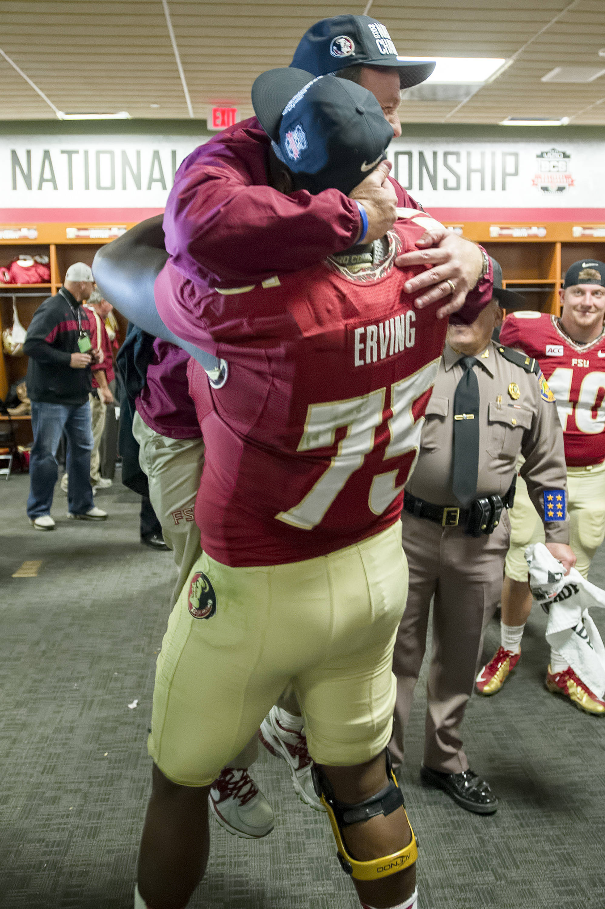 Cameron Erving (75) lifts Jimbo Fisher off the ground in the FSU locker room after the game