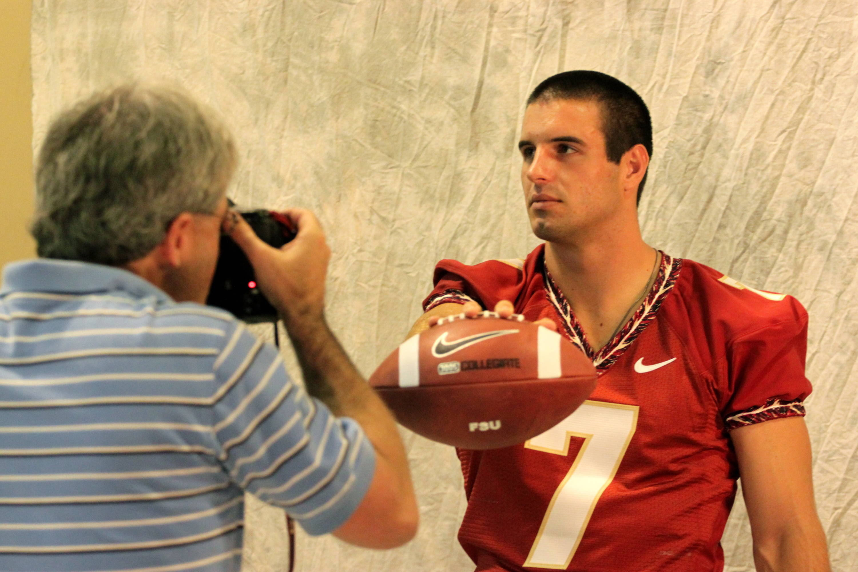 Christian Ponder posing for the camera at media day.