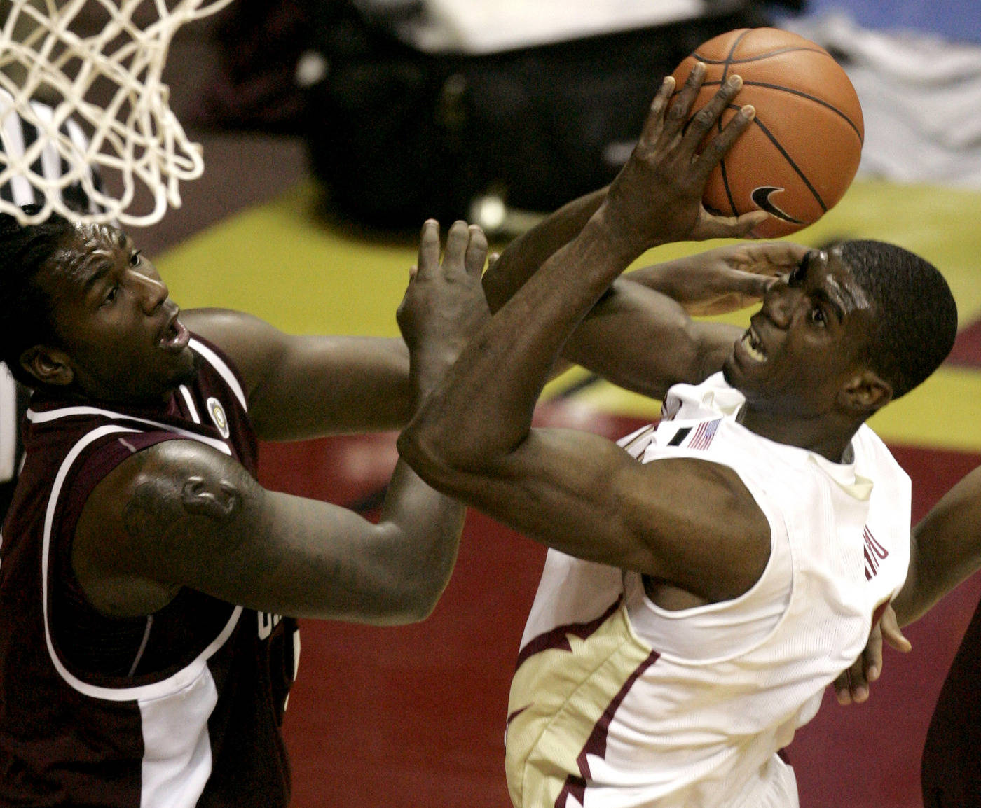 Uche Echefu attempts a first-half shot as College of Charleston's Jermaine Johnson defends in Tallahassee, Fla.(AP Photo/Phil Coale)