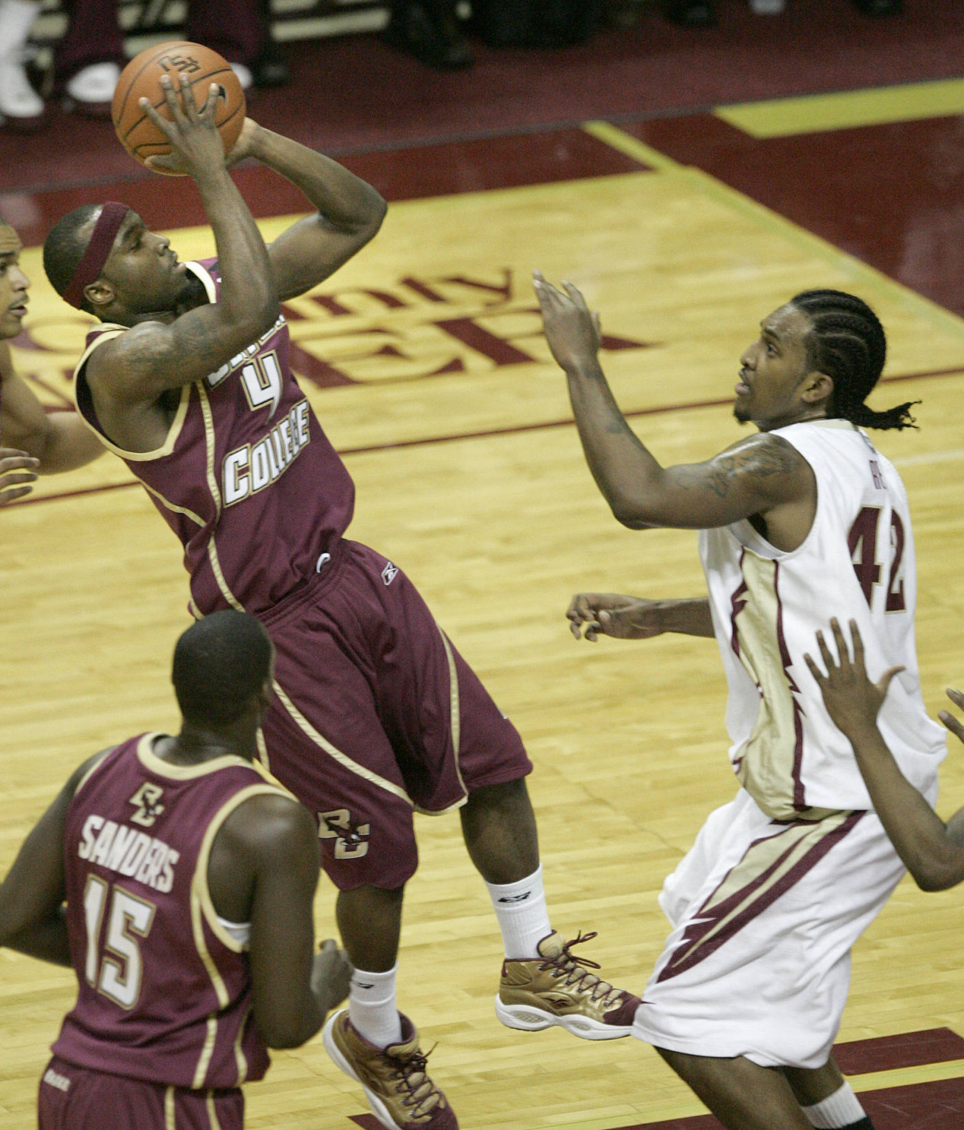 Boston College's Tyrese Rice gets off a shot as Ryan Reid rushes to defend in the first half. (AP Photo/Steve Cannon)