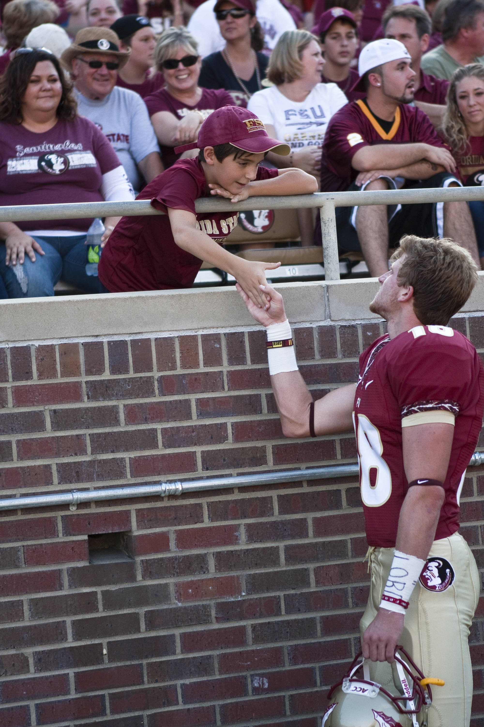 Dustin Hopkins (18) with a young Nole fan