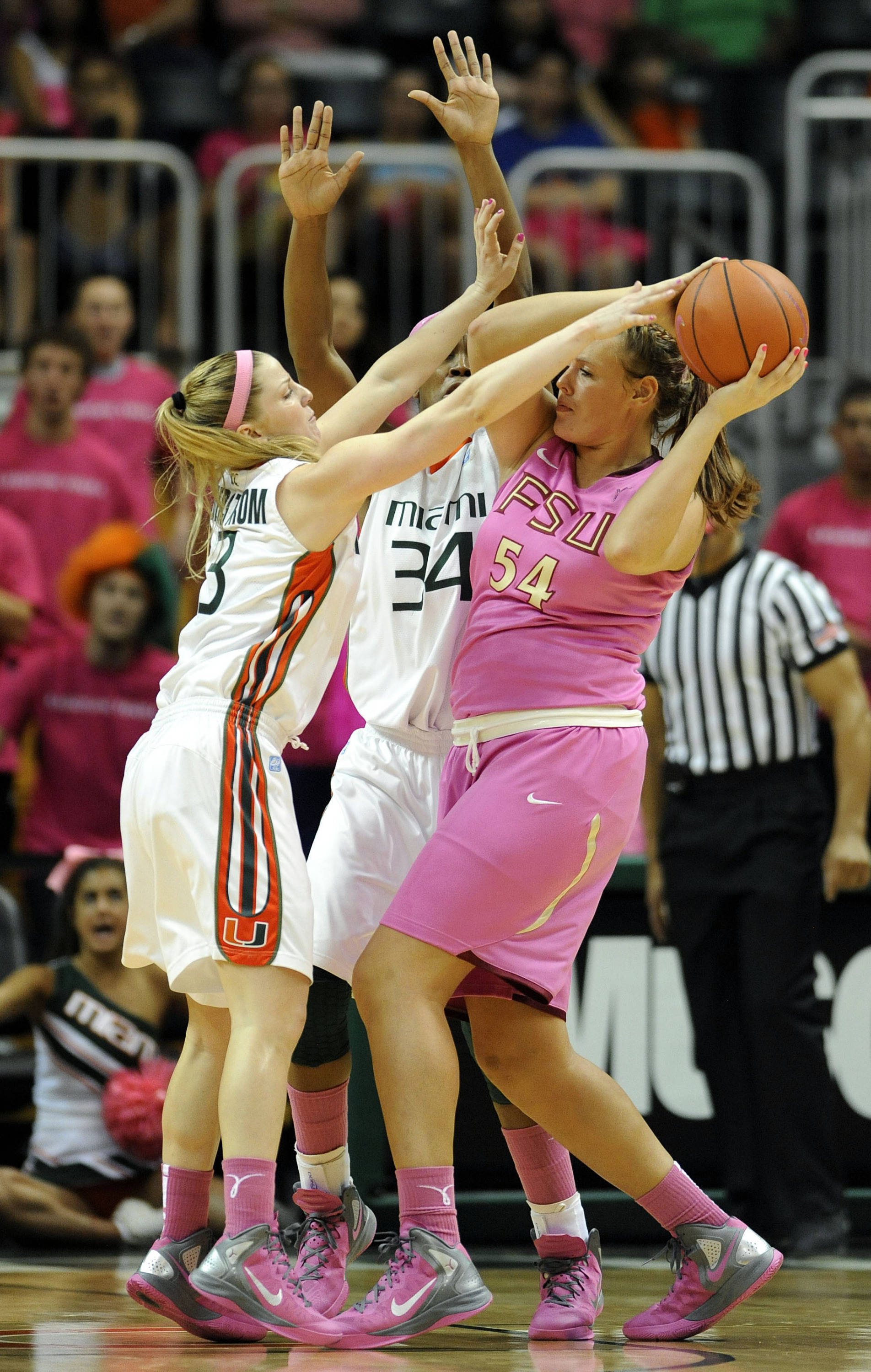 Miami's Stefanie Yderstrom, left, and Sylvia Bullock, center, defend Florida State's Cierra Bravard, right, during the first half of an NCAA college basketball game on Sunday, Feb. 19, 2012, in Coral Gables, Fla. (AP Photo/Rhona Wise)