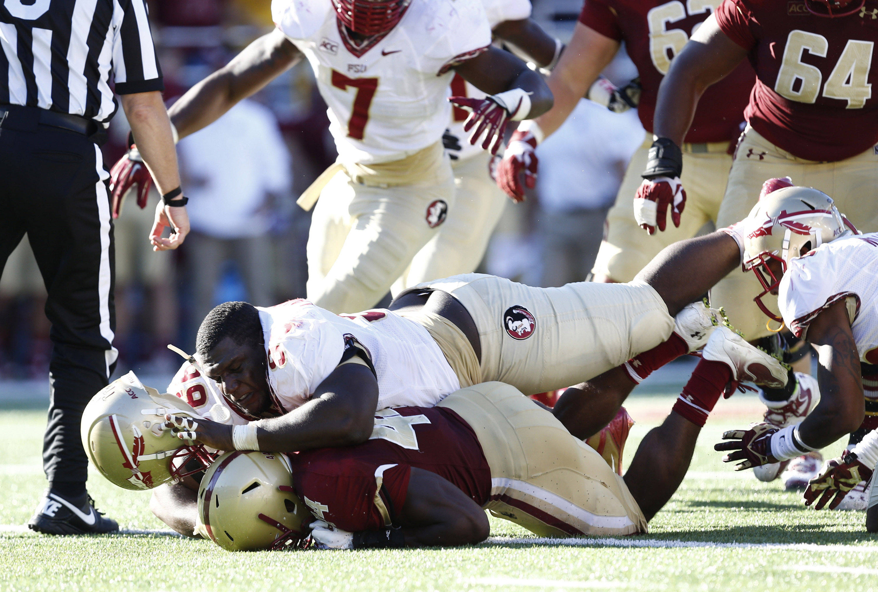Nile Lawrence-Stample (99) tackles Boston College Eagles running back Andre Williams (44). Mandatory Credit: Mark L. Baer-USA TODAY Sports