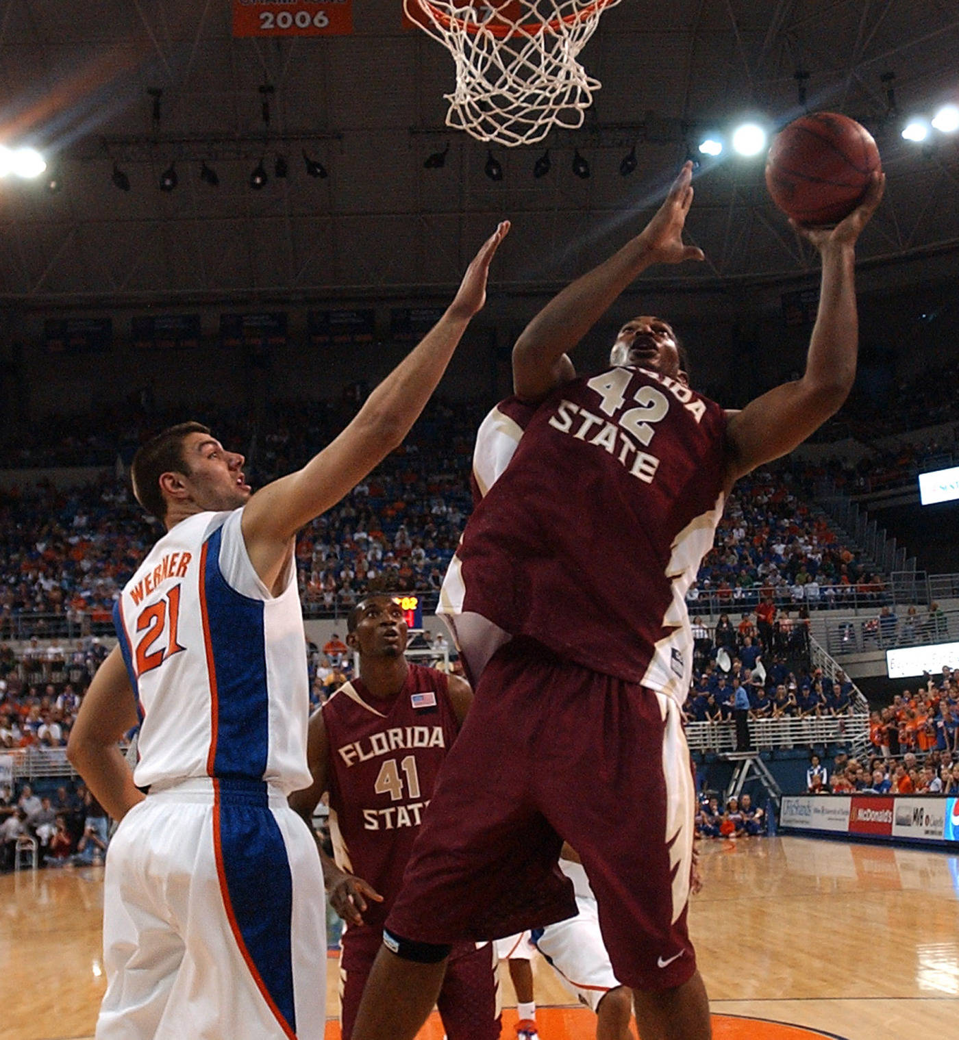 Florida State's Ryan Reid (42) goes up for a basket with Florida's Dan Werner (21) trying to block during the first half.
