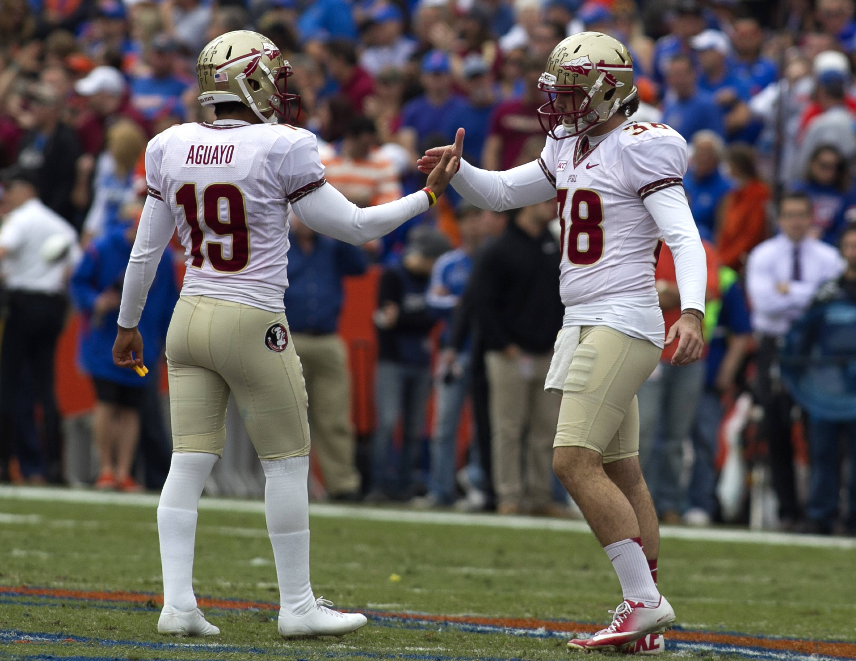Roberto Aguayo (19) and Cason Beatty (38) celebrate Aguayo's 50 yard field goal, FSU vs Florida, 11-30-13,  (Photo by Steve Musco)