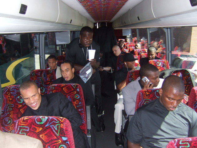 The team on the bus headed for the flight.