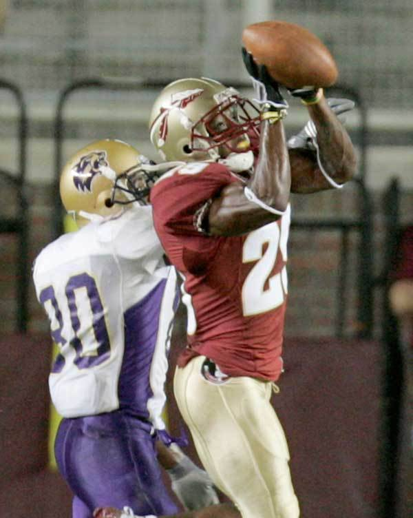 Florida State's Michael Ray Garvin, right, knocks down a second quarter pass intended for Western Carolina receiver Marquel Pittman