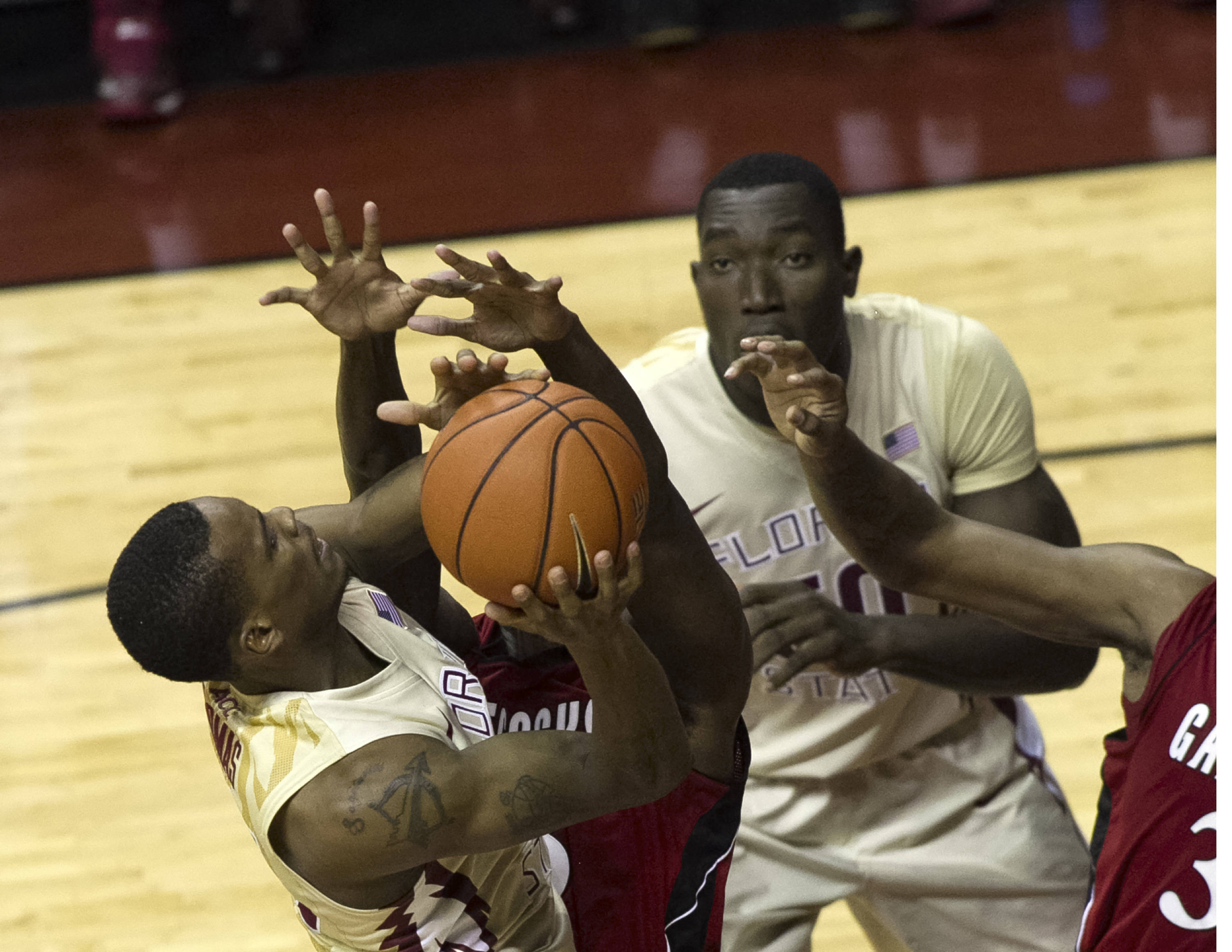 Aaron Thomas (25) with a difficult shot, FSU vs Jacksonville State, 12-08-13,  (Photo by Steve Musco)