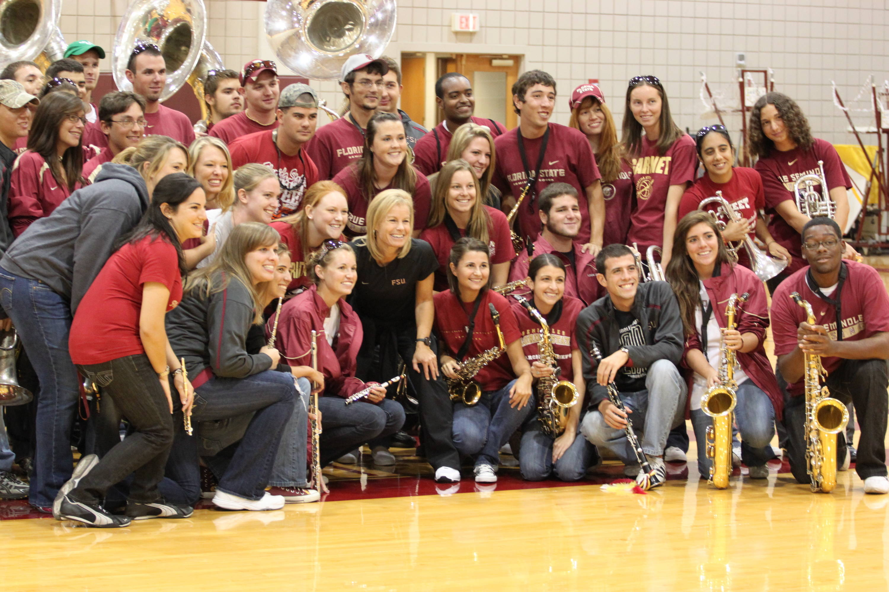 Head coach Sue Semrau posed with Seminole Sound after band was finished playing the Warchant.