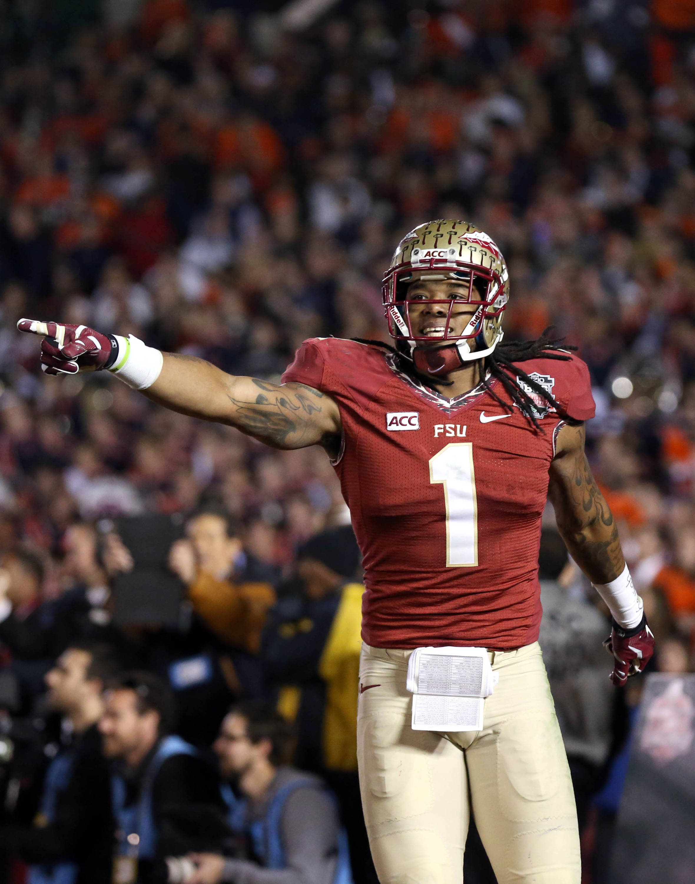 Jan 6, 2014; Pasadena, CA, USA; Florida State Seminoles wide receiver Kelvin Benjamin (1) celebrates his winning touchdown catch against the Auburn Tigers during the second half of the 2014 BCS National Championship game at the Rose Bowl.  Mandatory Credit: Matthew Emmons-USA TODAY Sports