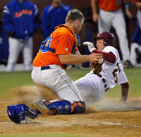 Mike McGee slides home safely in front of the tag to give FSU a 4-2 lead in the eighth.