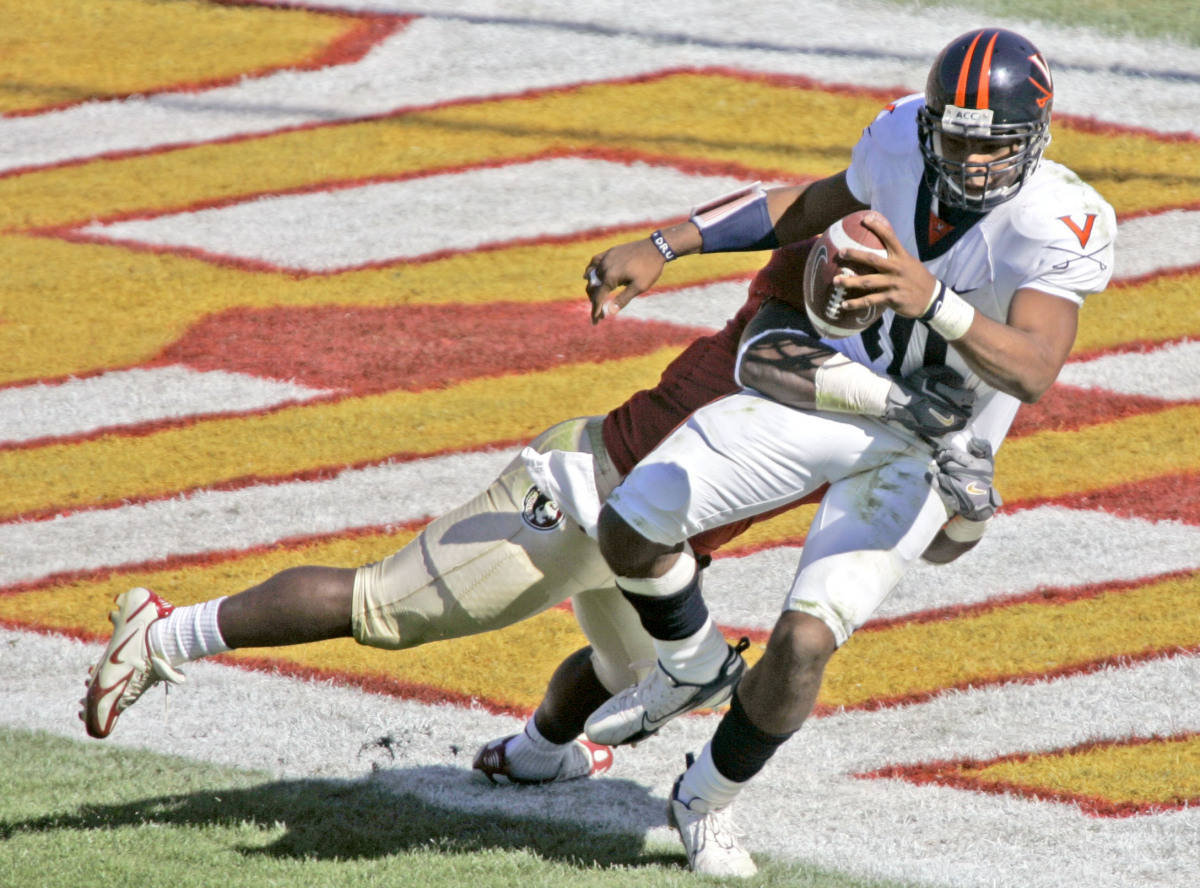 Virginia quarterback Jameel Sewell, right, is sacked in the end zone by Florida State's Buster Davis for a safety in the third quarter of a college football game Saturday, Nov. 4, 2006, in Tallahassee, Fla. FSU won 33-0. (AP Photo/Phil Coale)