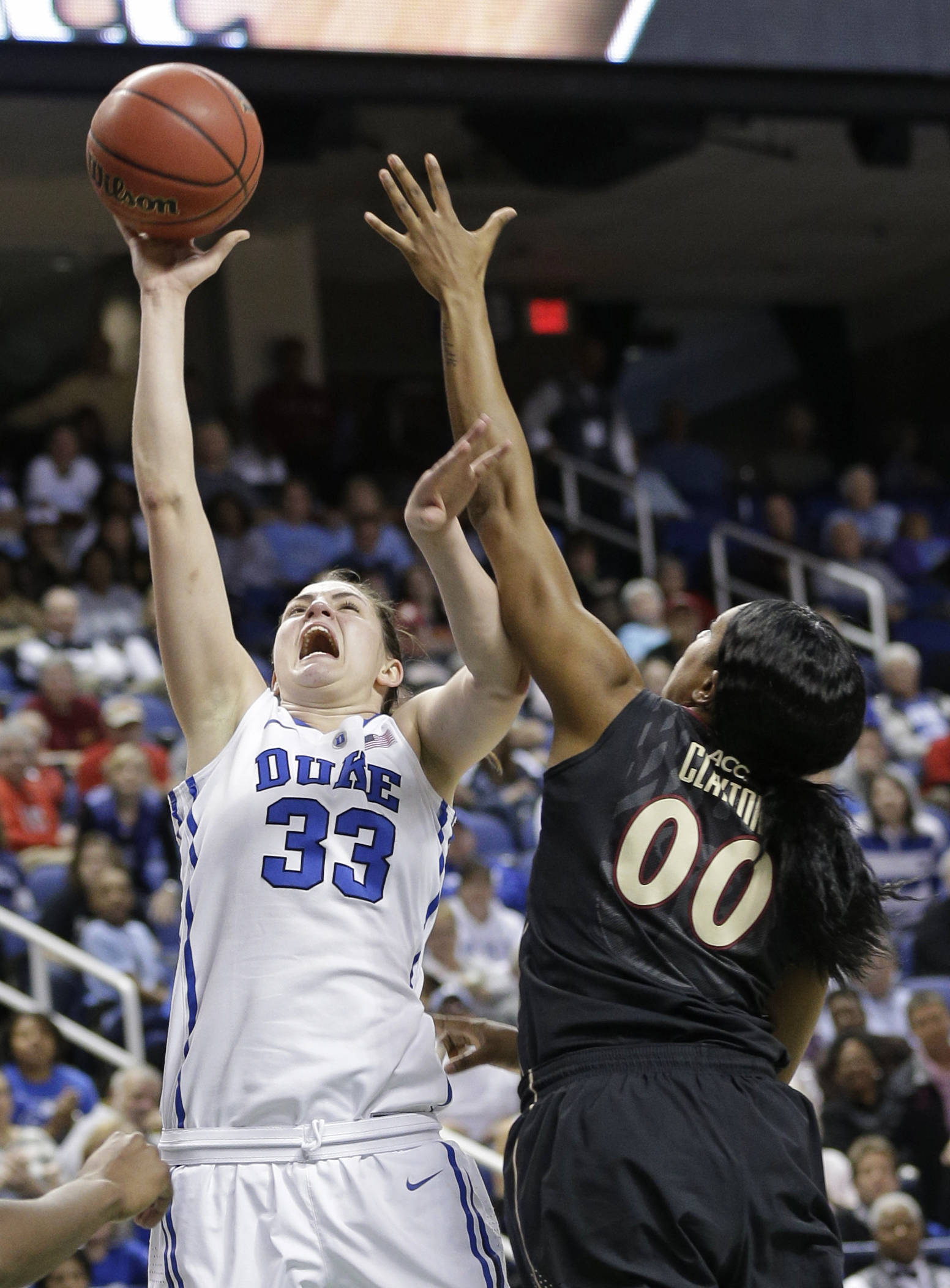 Duke's Haley Peters (33) shoot over Florida State's Chasity Clayton (00). (AP Photo/Chuck Burton)
