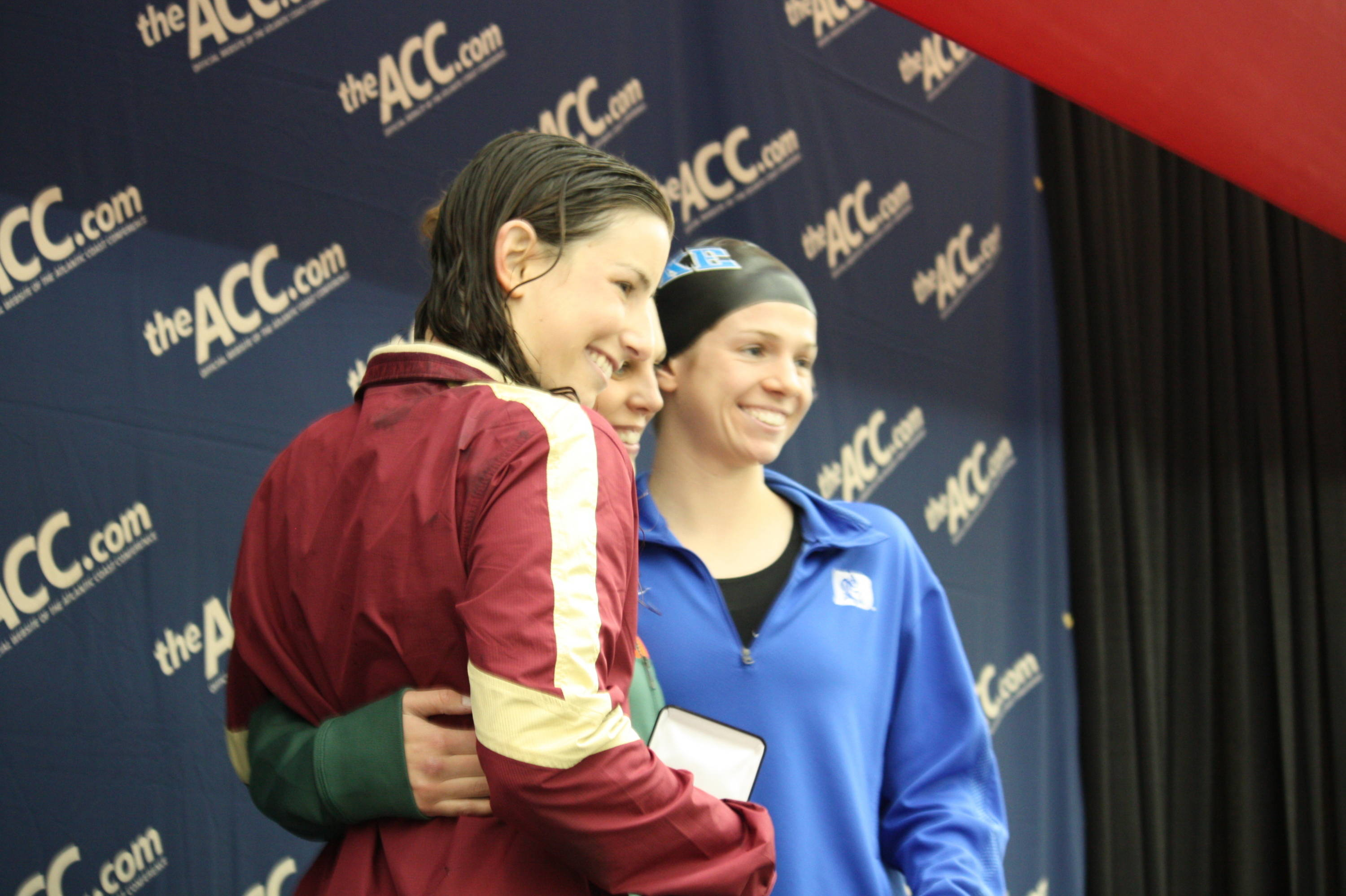 Melissa Cooper poses with the medalists for the 100 breast. Cooper claimed silver.