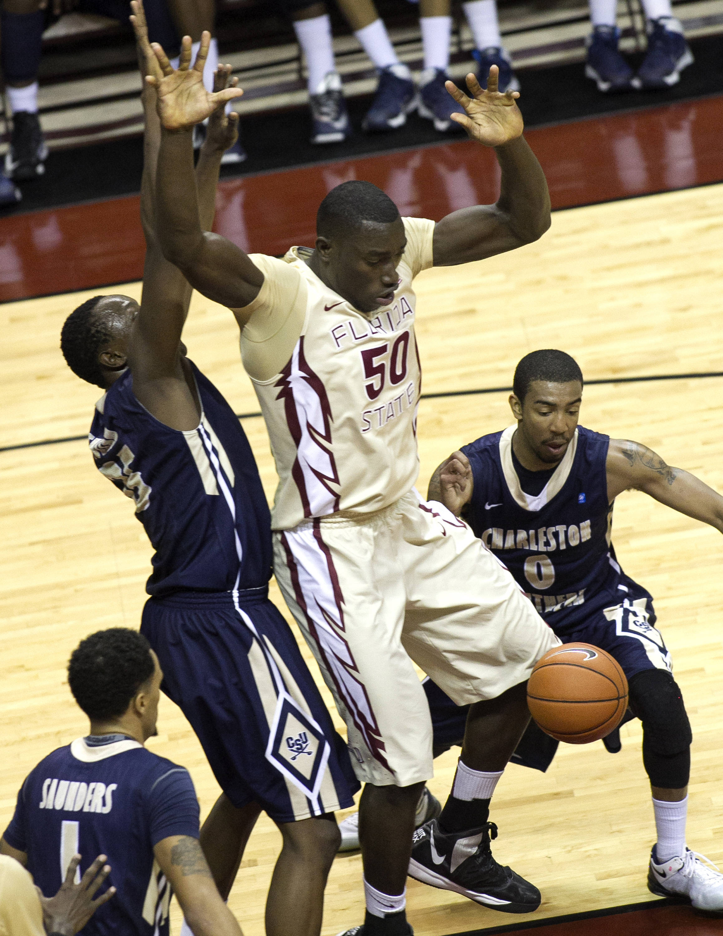 Michael Ojo (50) fighting for a loose ball, FSU vs Charleston Southern, 12-30-13,  (Photo by Steve Musco)