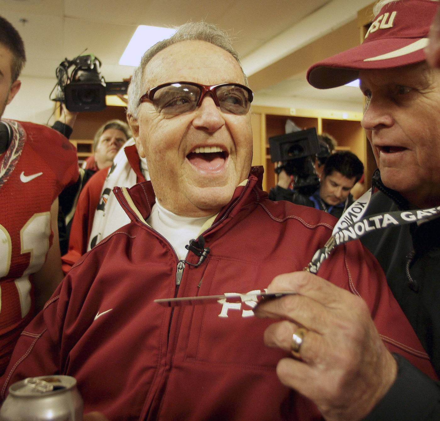 Florida State head coach Bobby Bowden is all smiles as he visits with people in the locker room after their 33-21 win over West Virginia in the Gator Bowl NCAA college football game, Friday, Jan. 1, 2010, in Jacksonville, Fla. (AP Photo/Phil Coale)