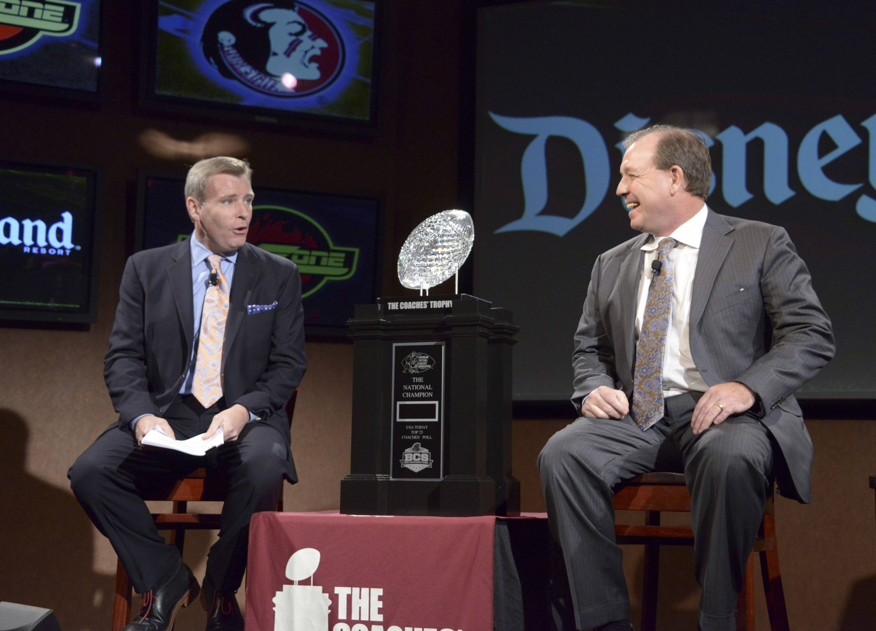 ESPN broadcaster Tom Rinaldi (left) interviews Florida State Seminoles coach Jimbo Fisher at a press conference for the 2014 BCS National Championship at ESPN Zone Downtown Disney. Mandatory Credit: Kirby Lee-USA TODAY Sports