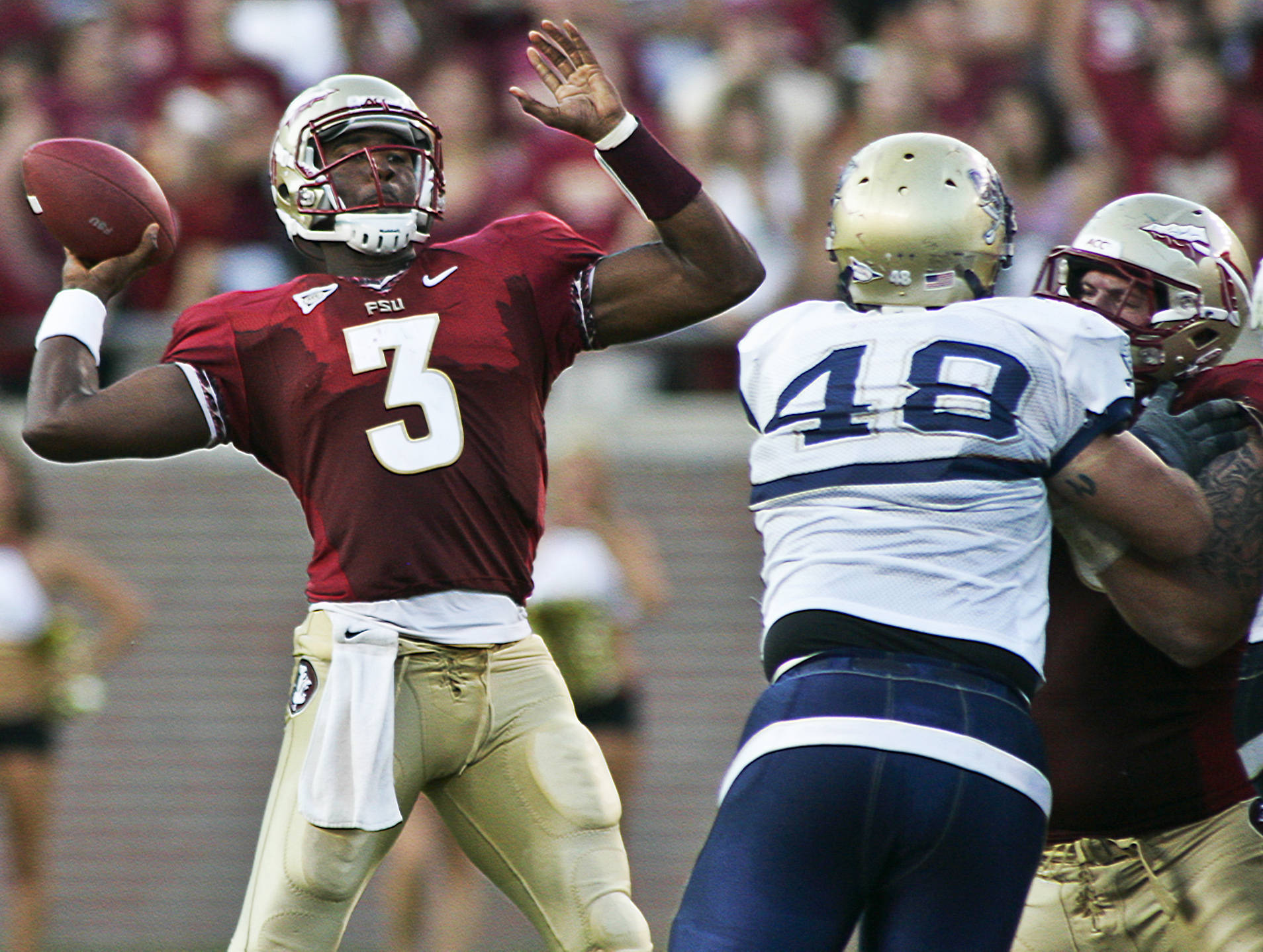 Florida State quarterback E.J. Manuel (3) gets a block as he throws against Charleston Southern in the second quarter of an NCAA college football game on Saturday, Sept. 10, 2011, in Tallahassee, Fla. (AP Photo/Phil Sears)