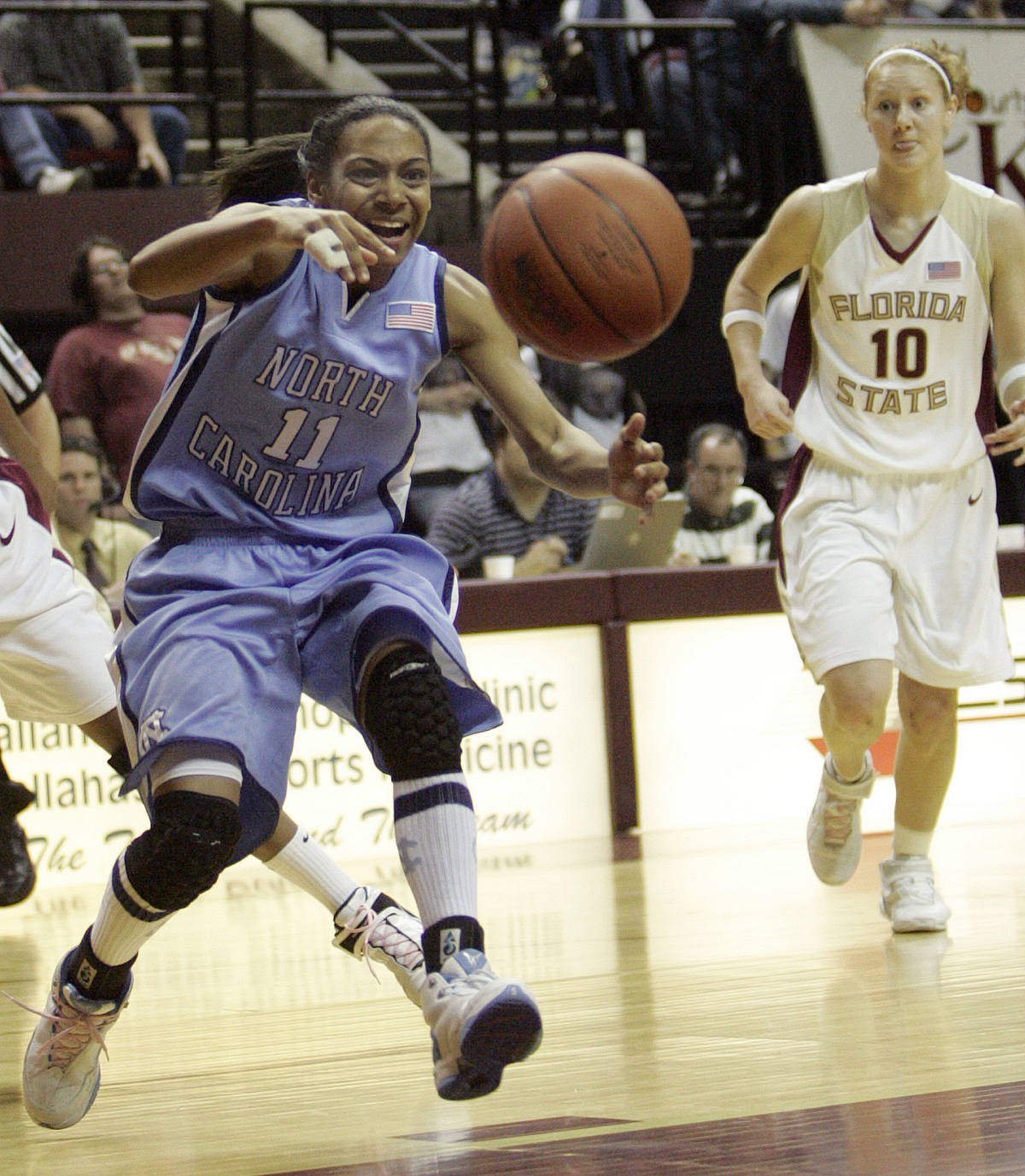 North Carolina's Alex Miller (11) tries to get a pass to a teammate as Florida State's Mara Freshour tries to catch up to the play in the first half of a college basketball game on Monday, Feb. 12, 2007 in Tallahassee, Fla. (AP Photo/Steve Cannon)