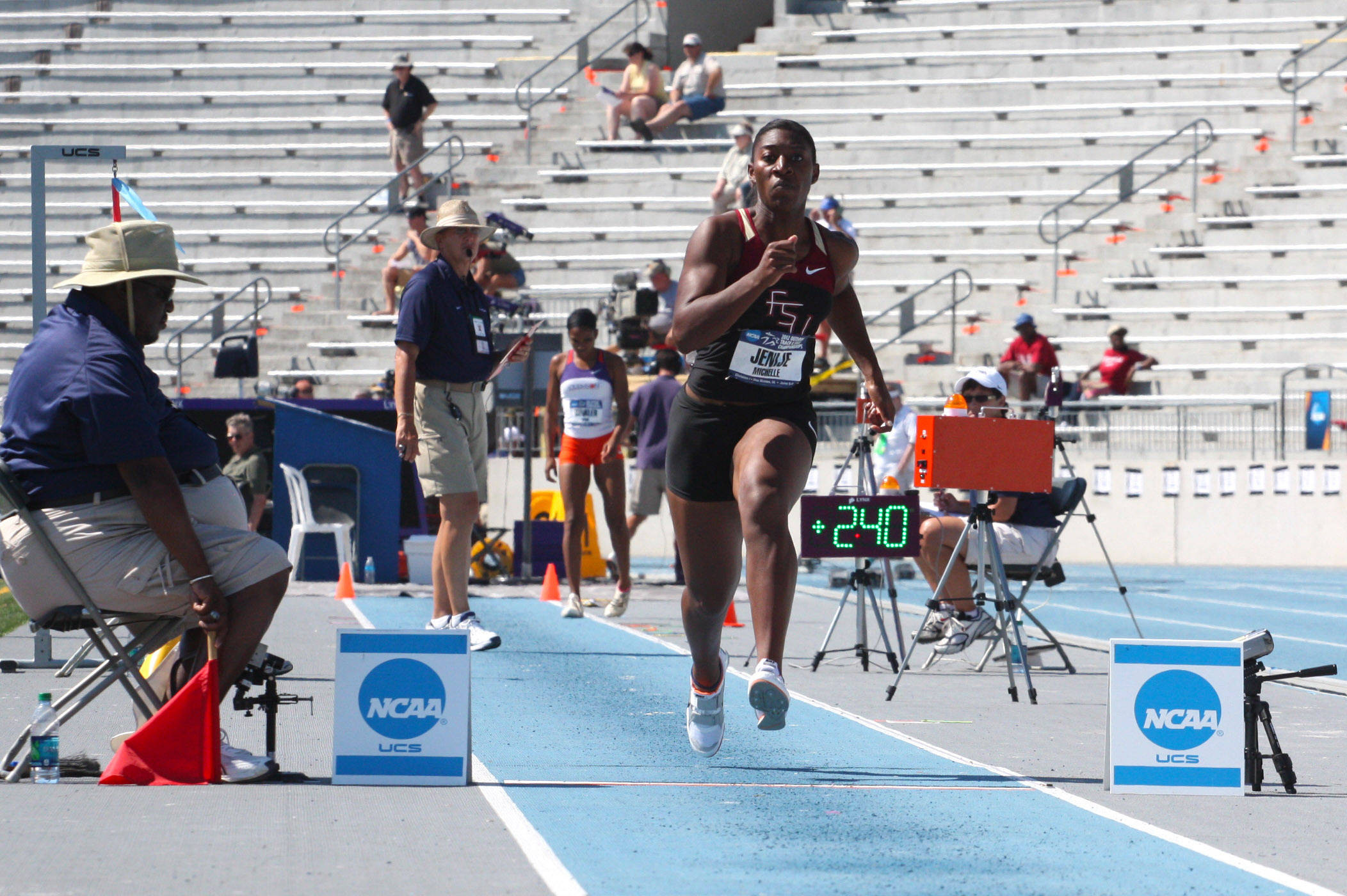 Michelle Jenije prepares for takeoff in the triple jump at NCAA