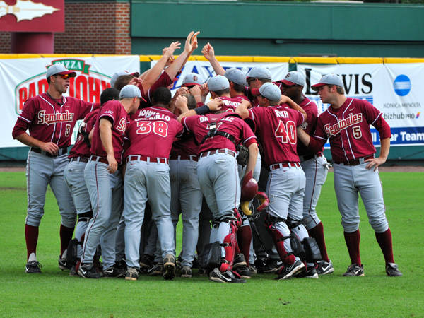 The Seminoles huddle before Saturday's contest against the Razorbacks
