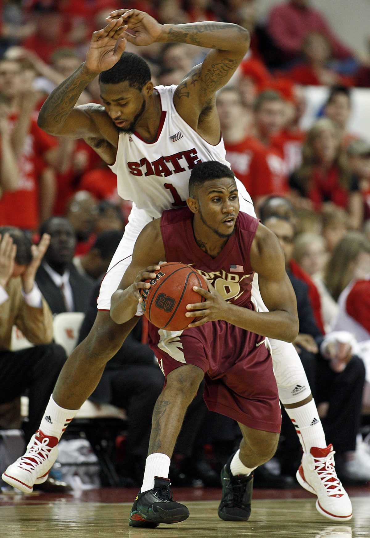 North Carolina State's Richard Howell (1) collides with Florida State's Ian Miller (30) during the second half of an NCAA college basketball game in Raleigh, N.C., Saturday, Feb. 18, 2012. Miller had 17 points to lead the Seminoles to a 76-62 win over NC State. (AP Photo/Karl B DeBlaker)