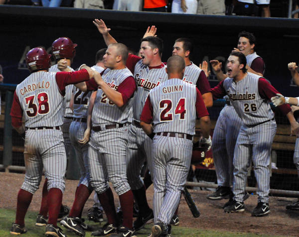 The Seminoles celebrate after tying the game at 5-5 in the top of the ninth inning.