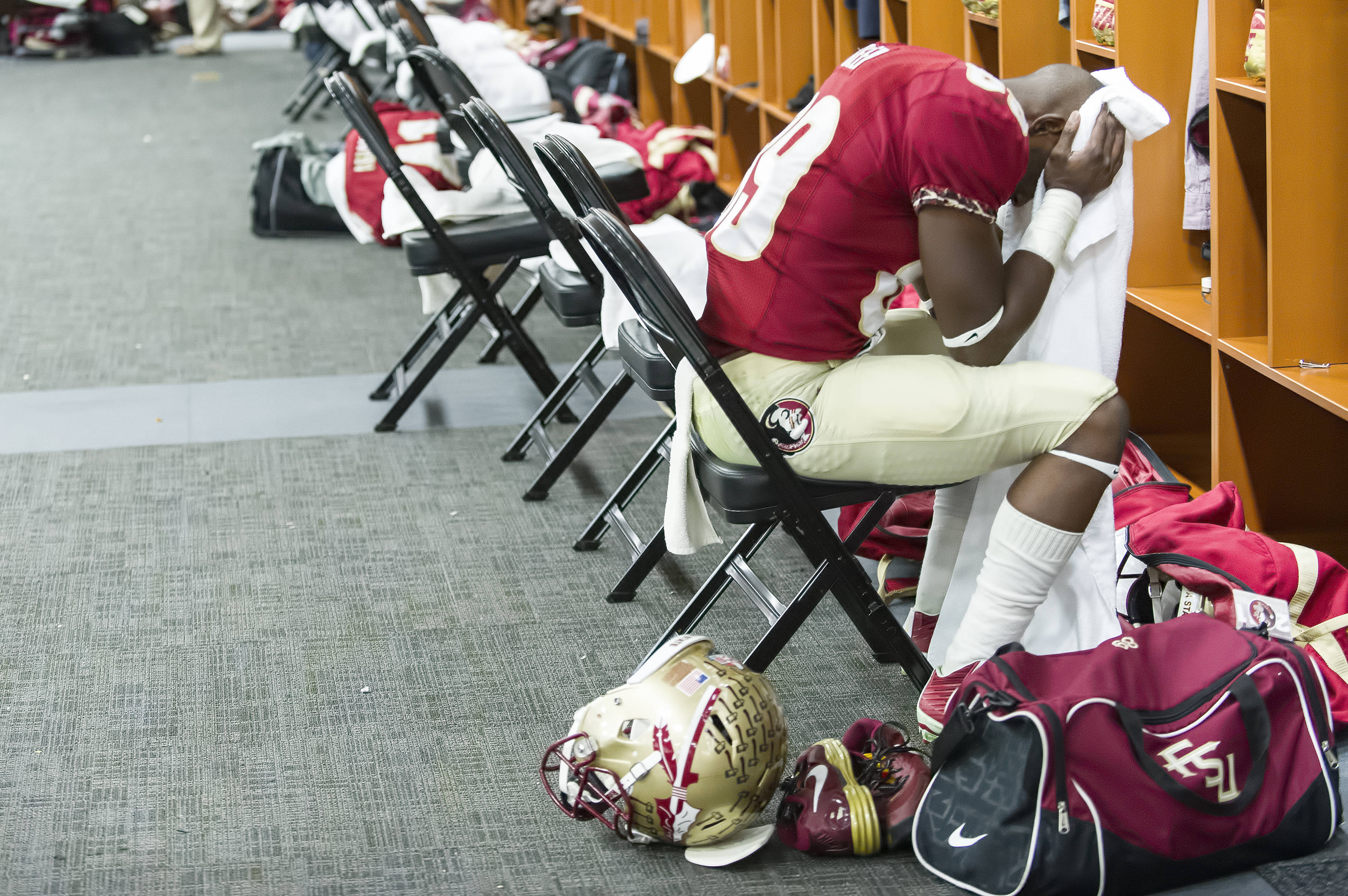 Christian Green (89) is overcome with emotion in the locker room after the victory