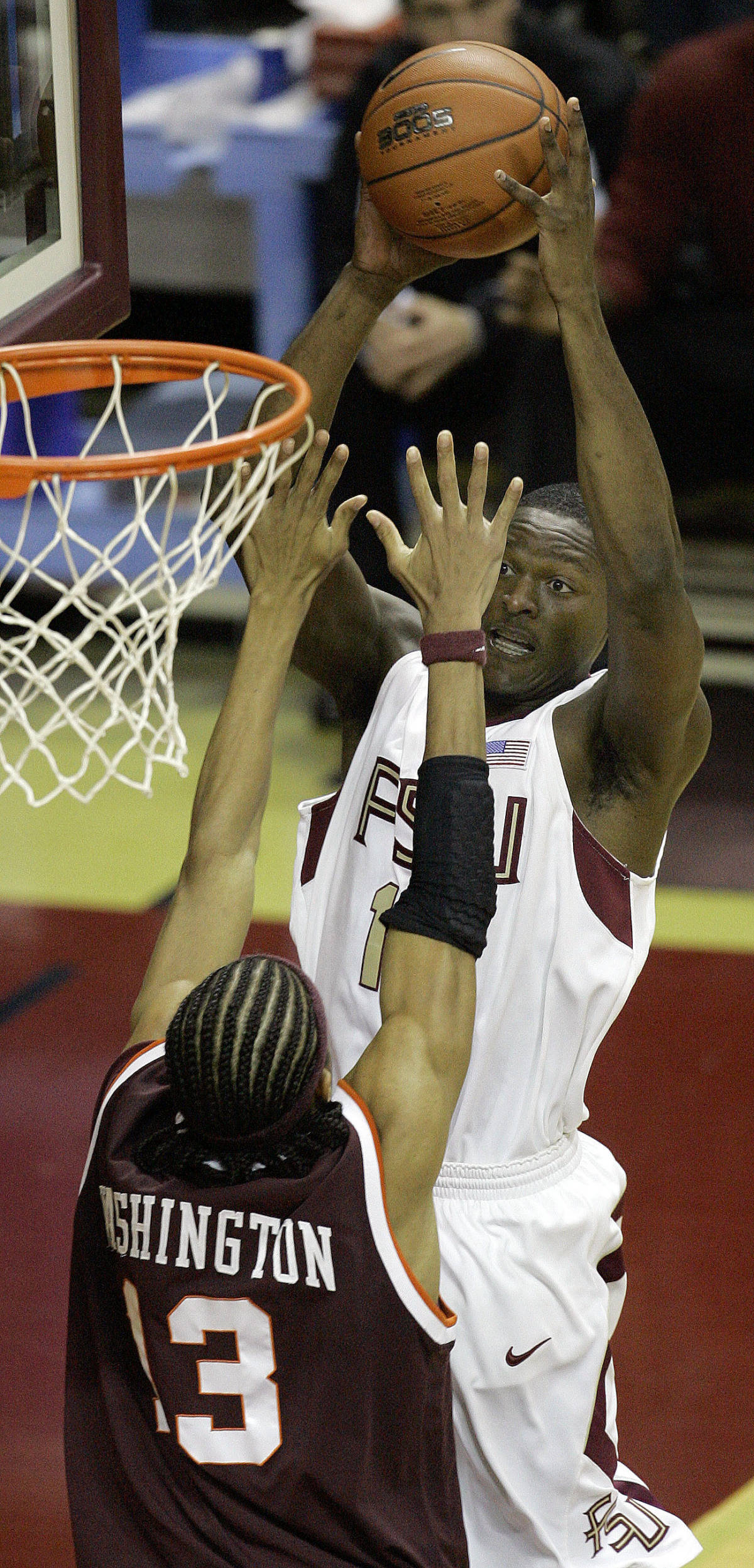 Florida State's Al Thornton, right, drives for two points as Virginia Tech's Deron Washington defends during the first half of a college basketball game, Wednesday, Jan. 17, 2007, in Tallahassee, Fla.(AP Photo/Phil Coale)