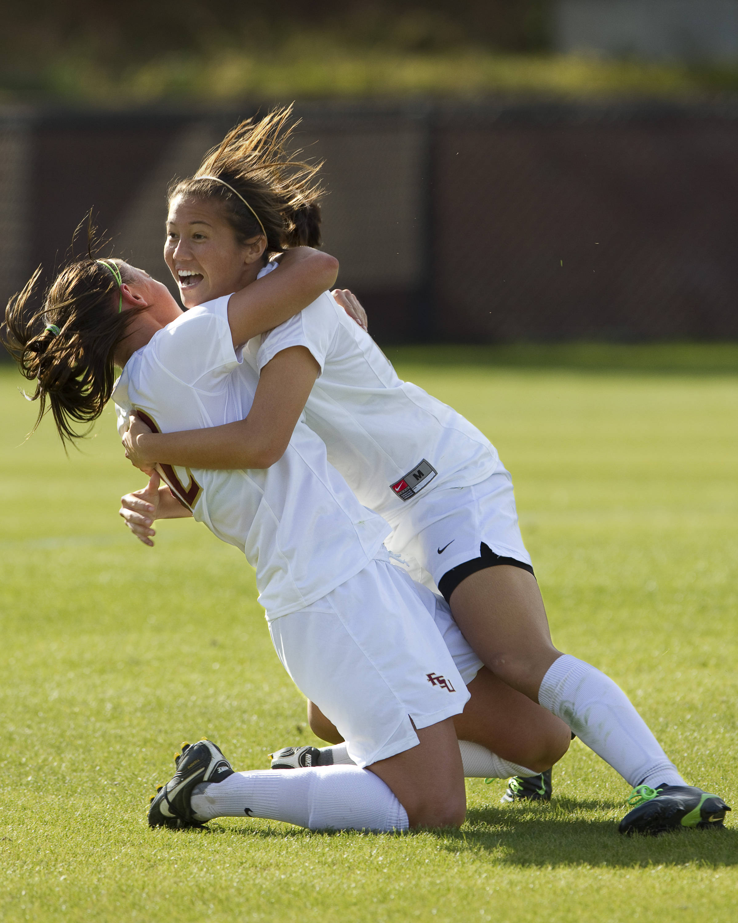 Breezy Hupp (12) and Ines Jaurena (2) celebrate after Hupp's goal.