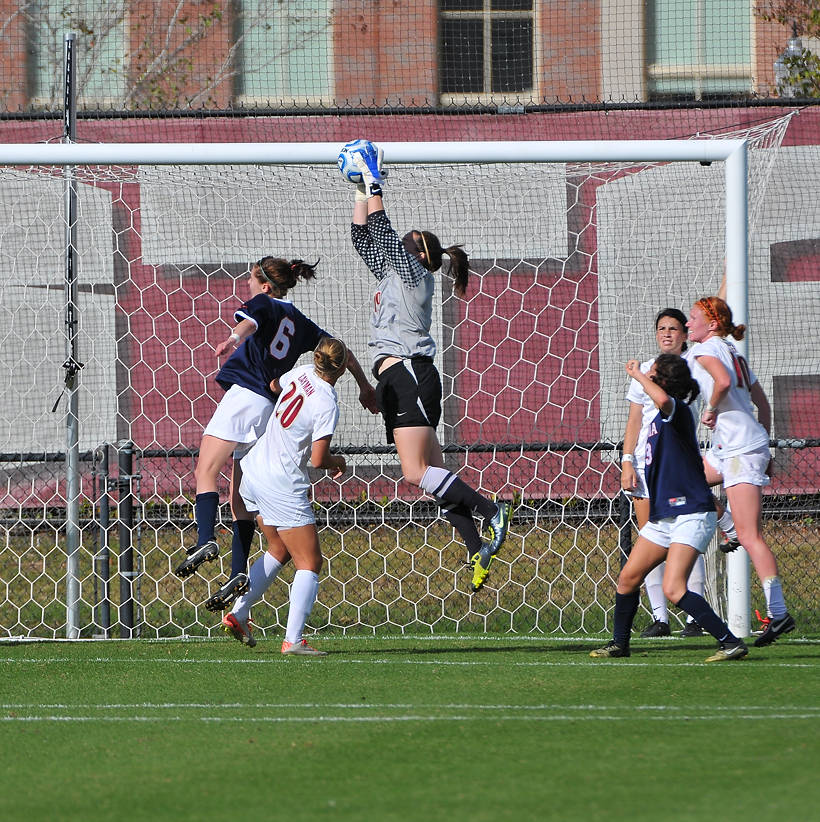 Kelsey Wys comes out to grab the ball off a Virginia corner