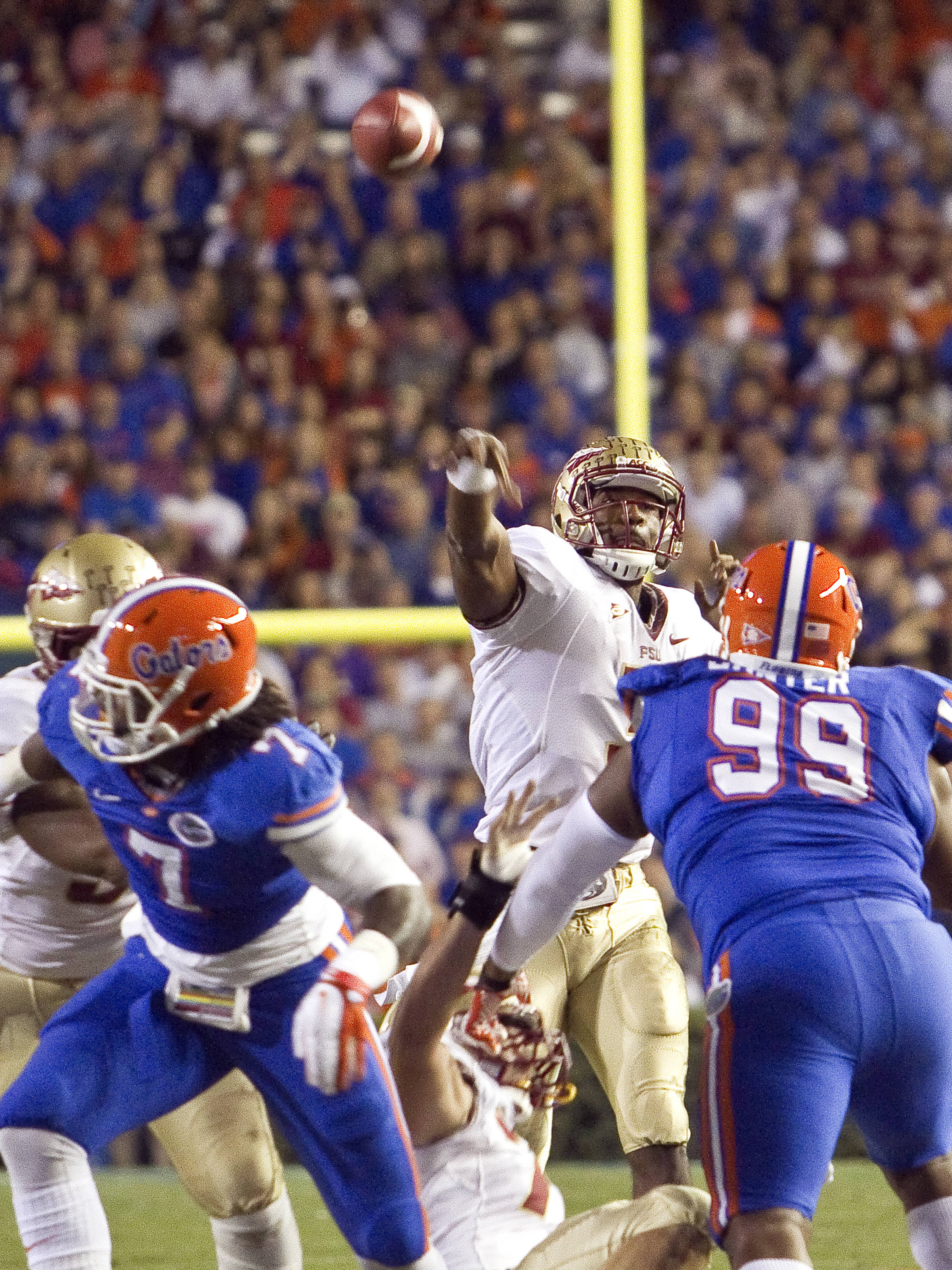 EJ Manuel (3) throwing over a Florida rush, FSU vs Florida, 11/26/2011