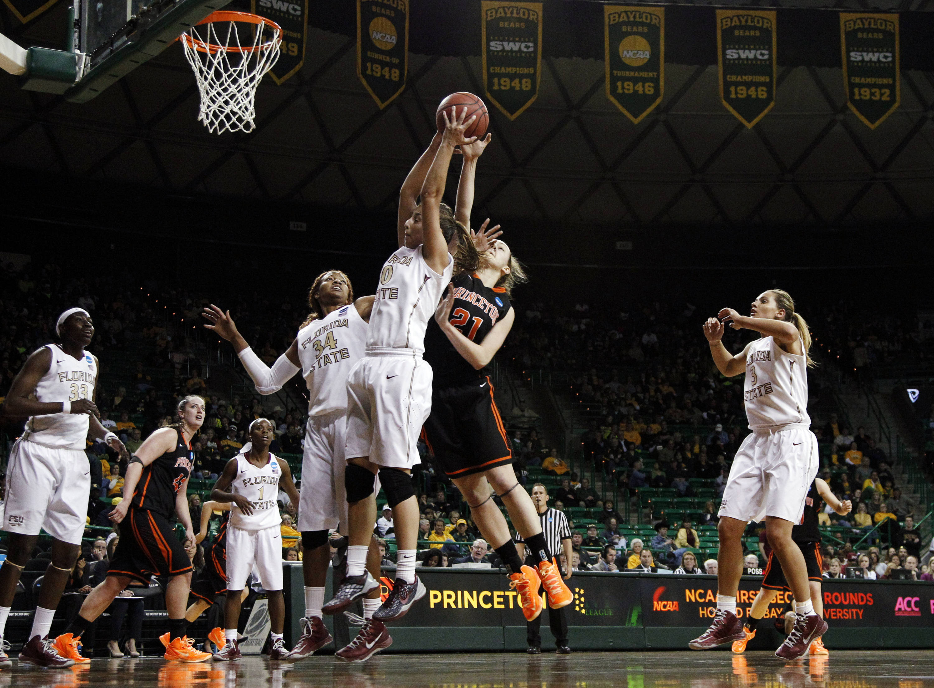 Florida State's Chelsea Davis (34) and Leonor Rodriguez, center left, combine to grab a rebound in front of Princeton's Alex Wheatley (21) in the second half. (AP Photo/Tony Gutierrez)