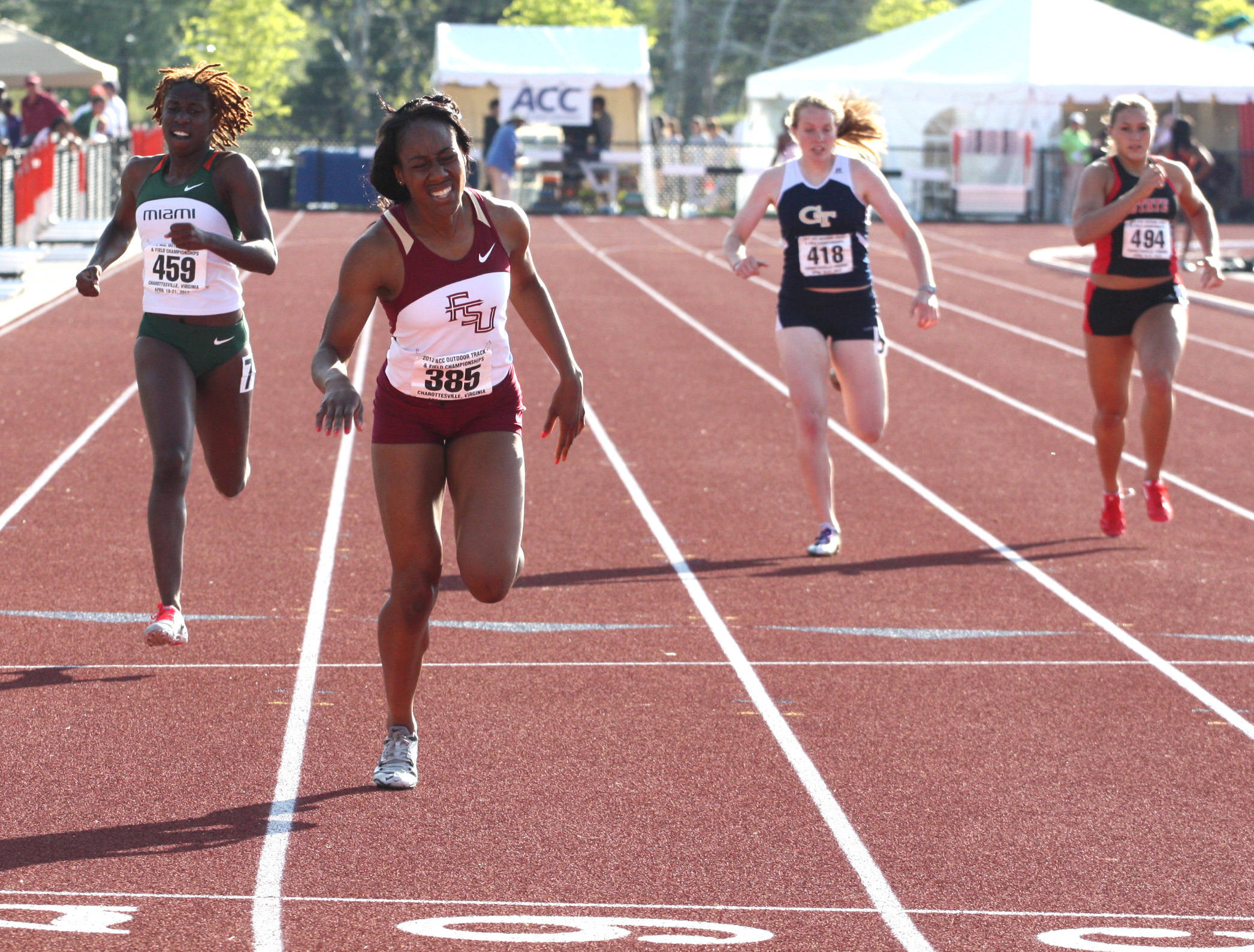 Sophomore Elizabeth Ichite strains to hold on to the final qualifying spot during the 400-meter dash preliminary heat.