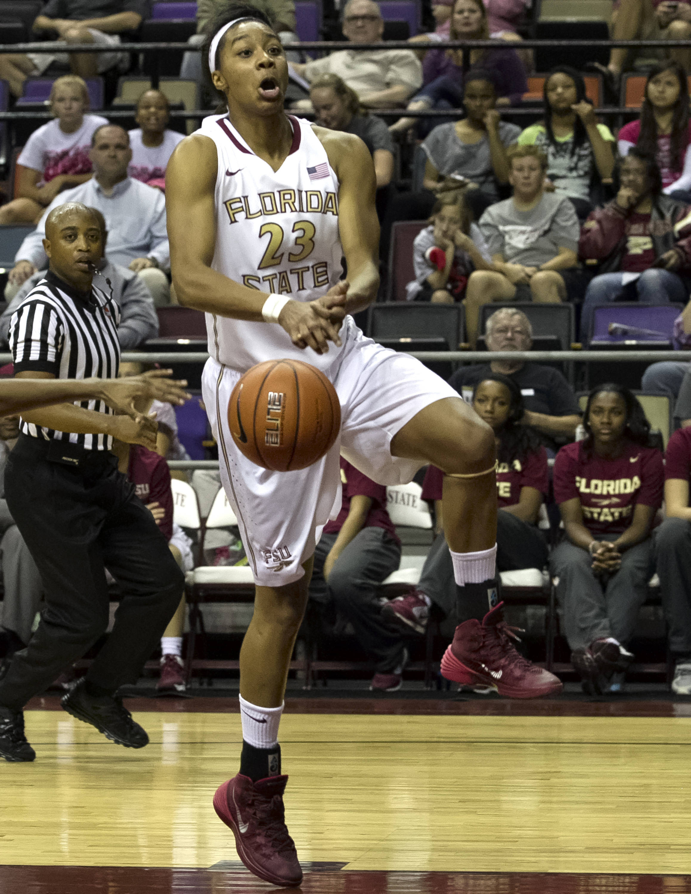 Ivey Slaughter (23), get the ball knocked out of her hands, FSU vs Jacksonville, 12-08-13,  (Photo by Steve Musco)
