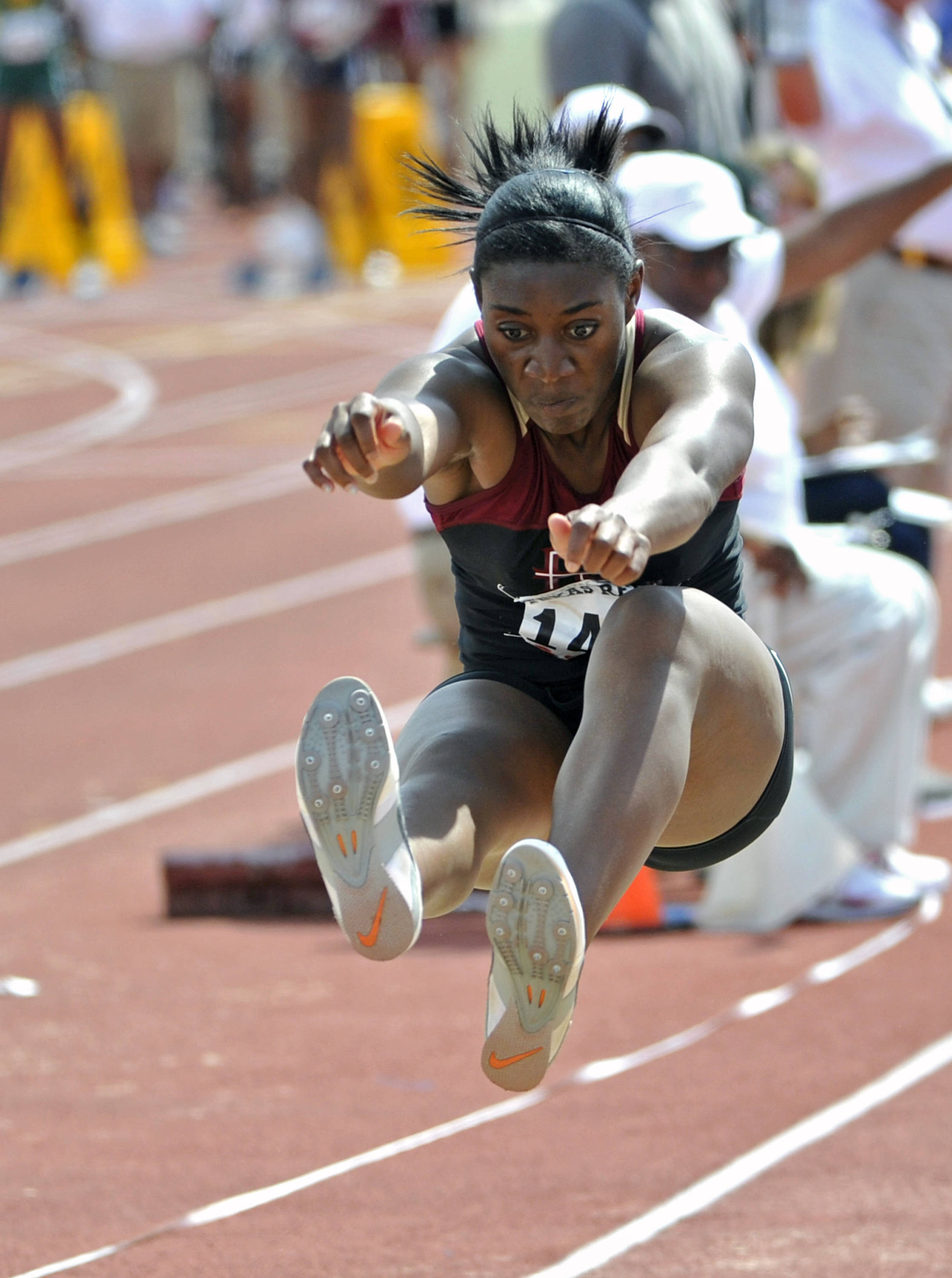 Florida State's Michelle Jenije competes in the women's triple jump during the Texas Relays athletics meet on Friday, March 30, 2012, in Austin, Texas. (AP Photo/Michael Thomas)