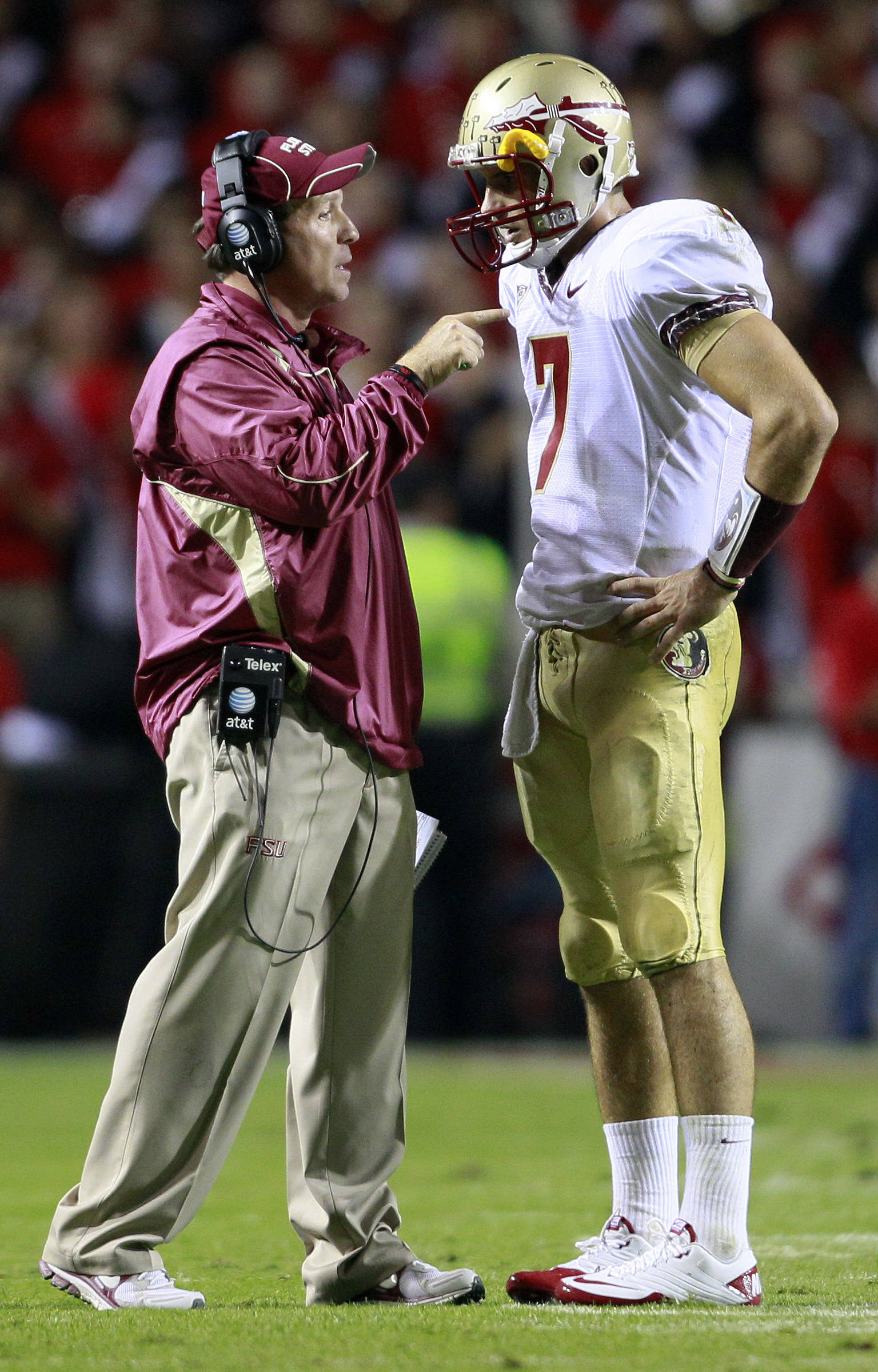 Florida State coach Jimbo Fisher speaks with quarterback Christian Ponder (7) during the first half of an NCAA college football game against North Carolina State in Raleigh, N.C., Thursday, Oct. 28, 2010. (AP Photo/Gerry Broome)