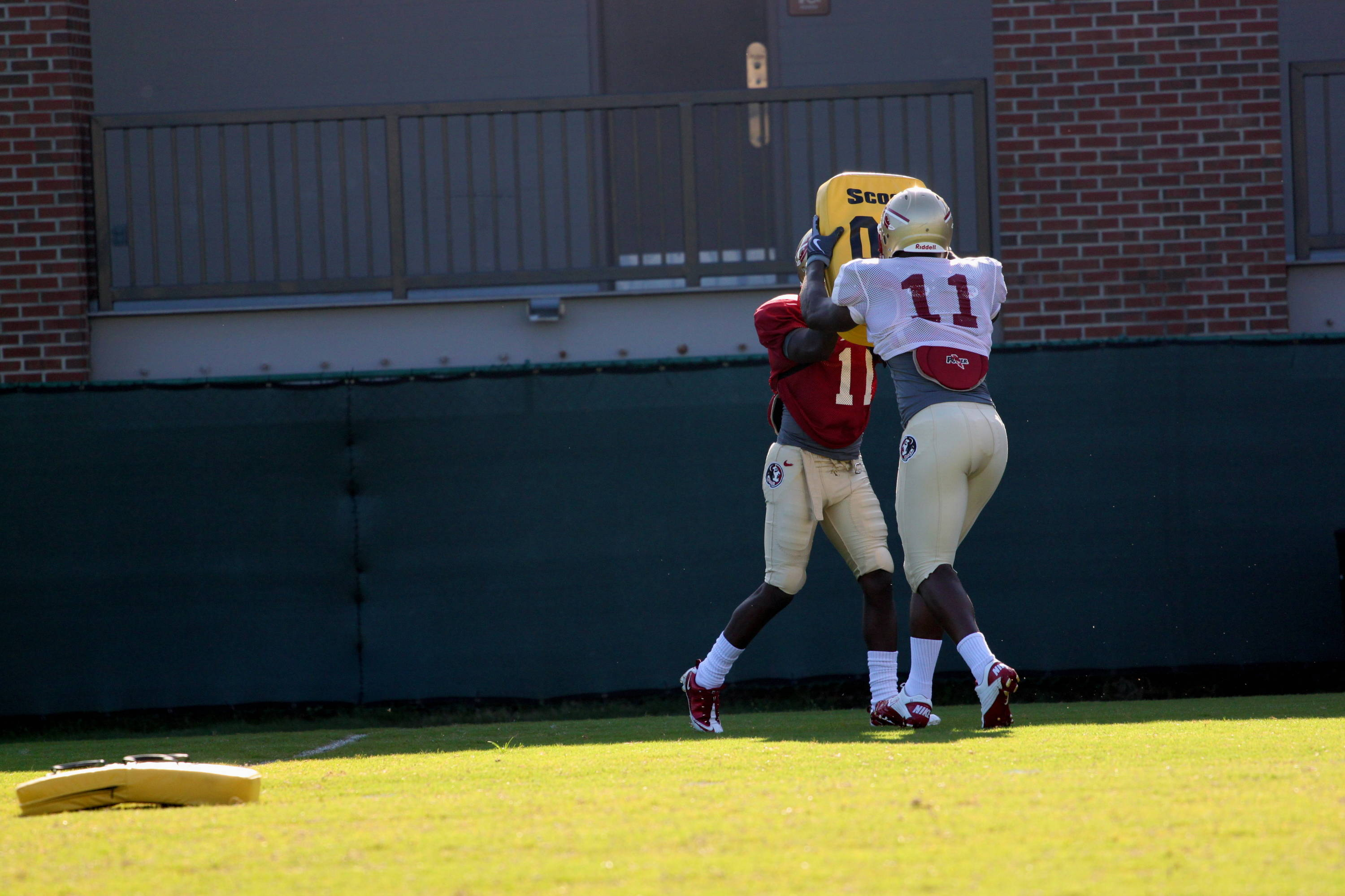 Vince Williams (11) blocks downfield during a punt drill