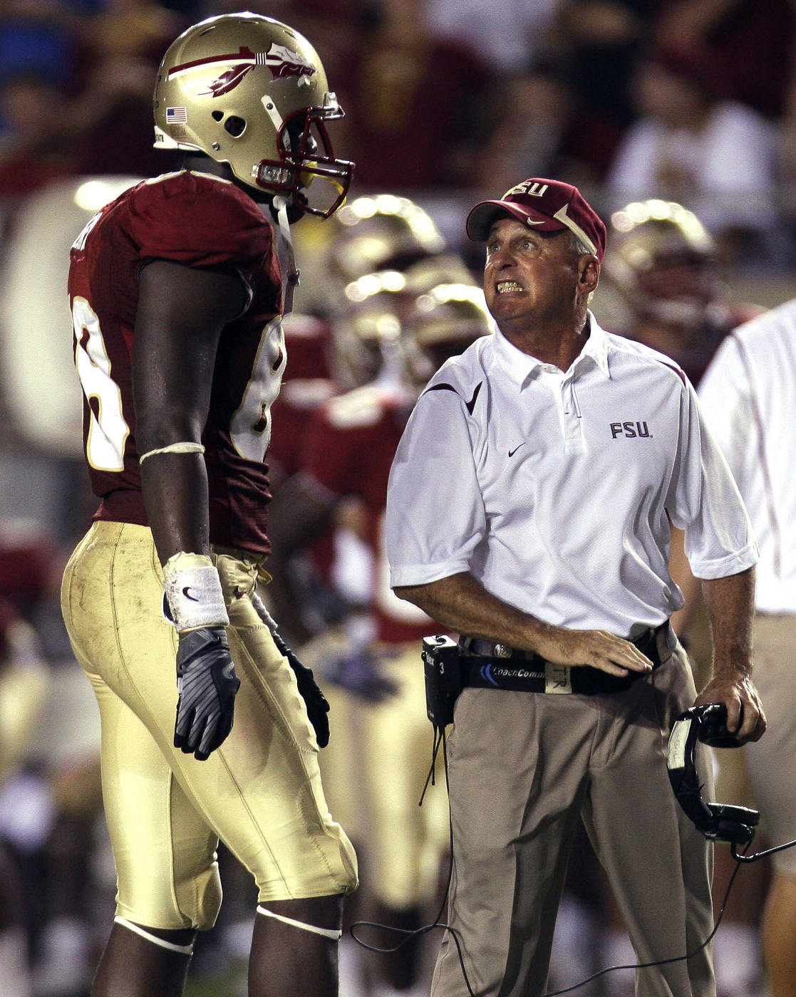 Florida State offensive line coach Rick Trickett, right, scolds Florida State tight end Beau Reliford for a holding penalty during an NCAA college football game against Georgia Tech, Saturday, Oct. 10, 2009, in Tallahassee, Fla.