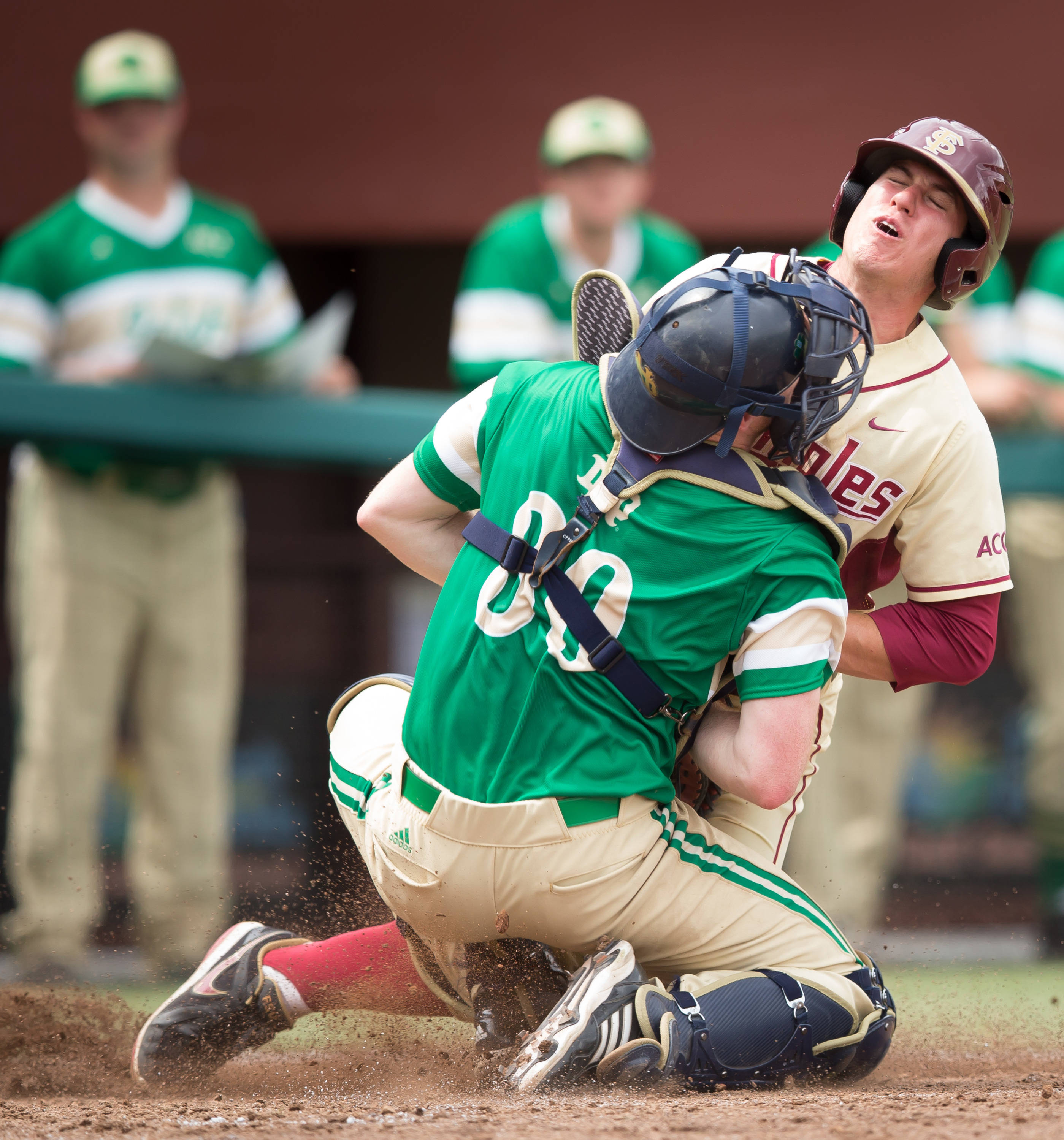 Josh Delph (2) collides with the Notre Dame catcher attempting to score in Game 2.  Delph was safe when the catcher dropped the ball.